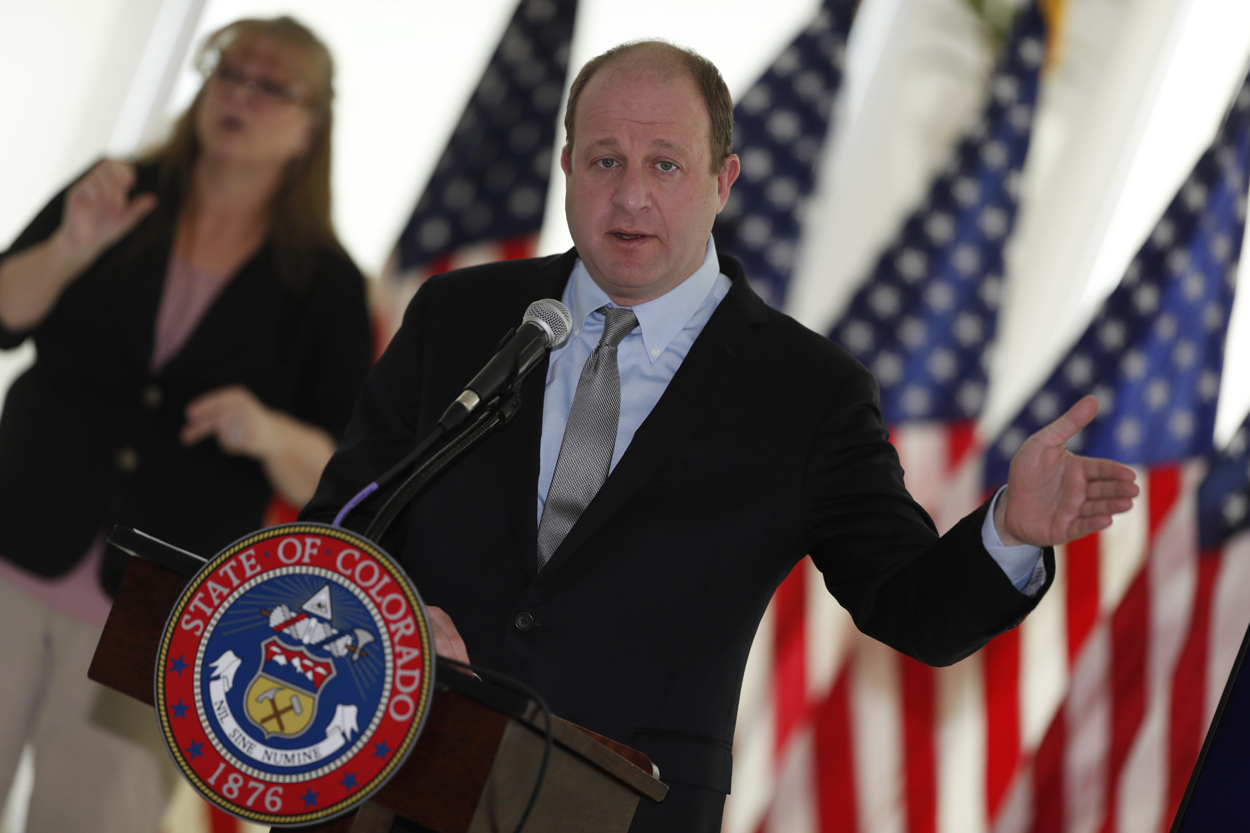 Colorado Gov. Jared Polis makes a point during a news conference as a statewide stay-at-home order remains in effect in an effort to reduce the spread of the new coronavirus Wednesday, April 8, 2020, in the governor's mansion in Denver.
