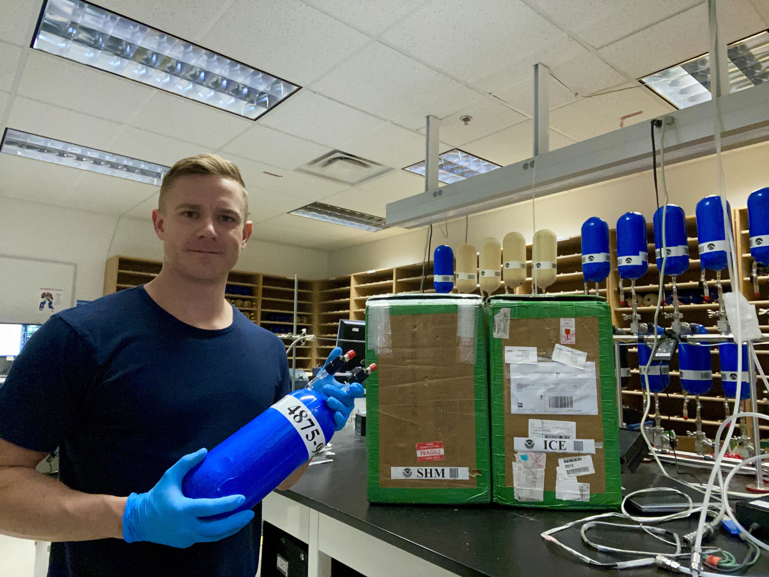 Associate Research Scientist Eric Moglia inside the Flask Logistics Lab at the National Oceanic and Atmospheric Administration in Boulder.