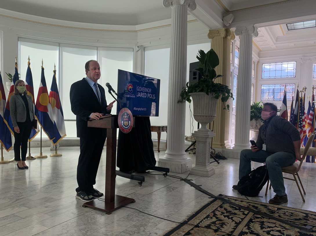 Colorado Gov. Jared Polis speaks at a press briefing on the state's response to the coronavirus pandemic at the governor's residence at Boettcher Mansion in Denver, Wednesday, April 8, 2020.
