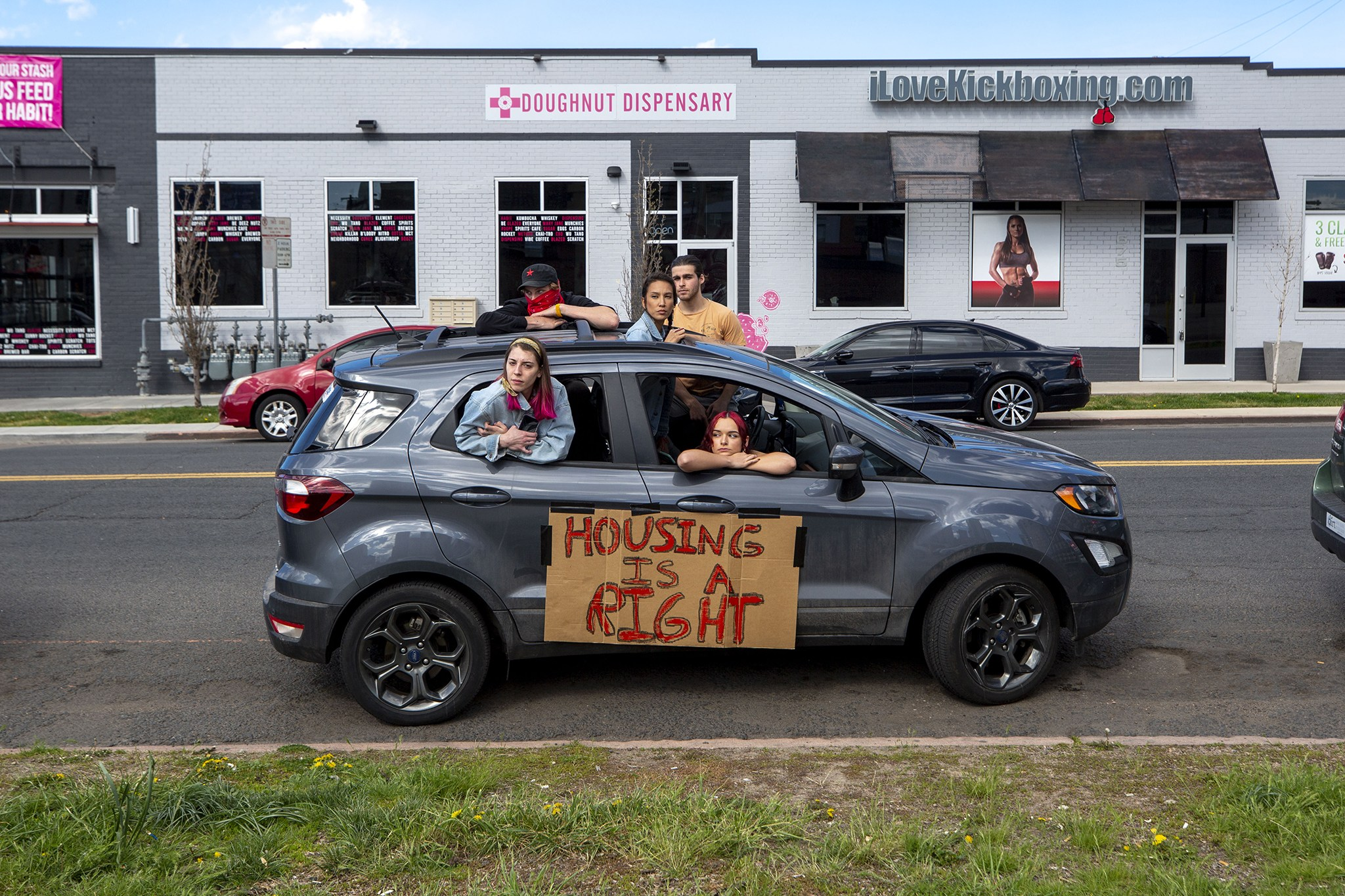 A caravan-style protest demanded a rent and mortgage pause, among other causes, early on in the pandemic. April 25, 2020. (Kevin J. Beaty/Denverite)