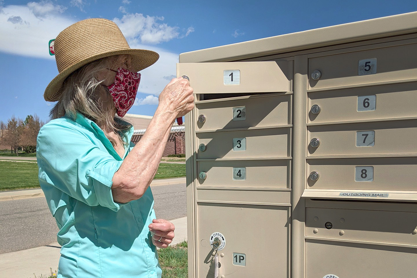 Carol Guerrero-Murphy, an instructor with Adams State University's Prison College Program, checks her mailbox for assignments sent from her students who are incarcerated.