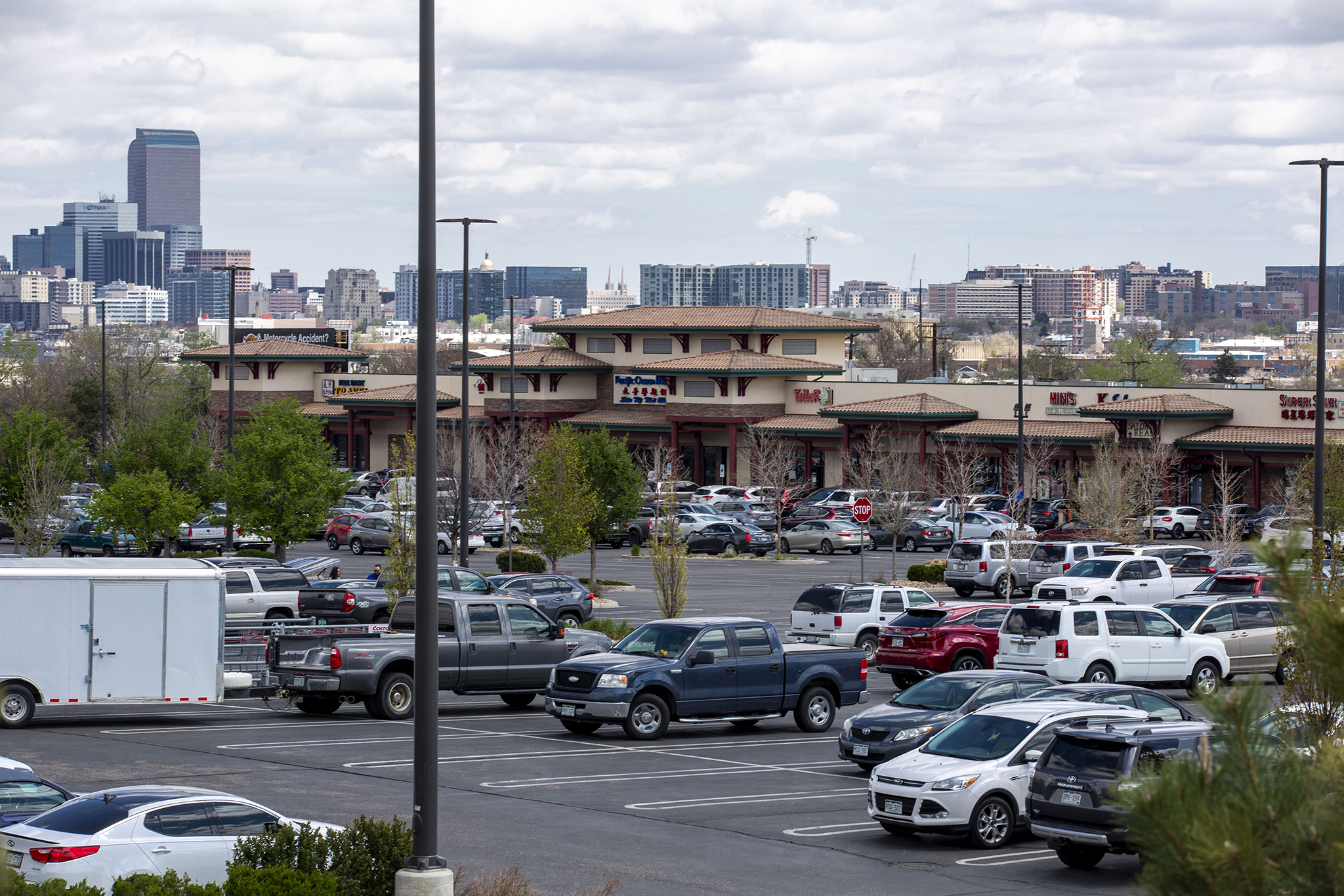 The parking lot surrounding Denver's Pacific Ocean Marketplace is full of cars. May 9, 2020.
