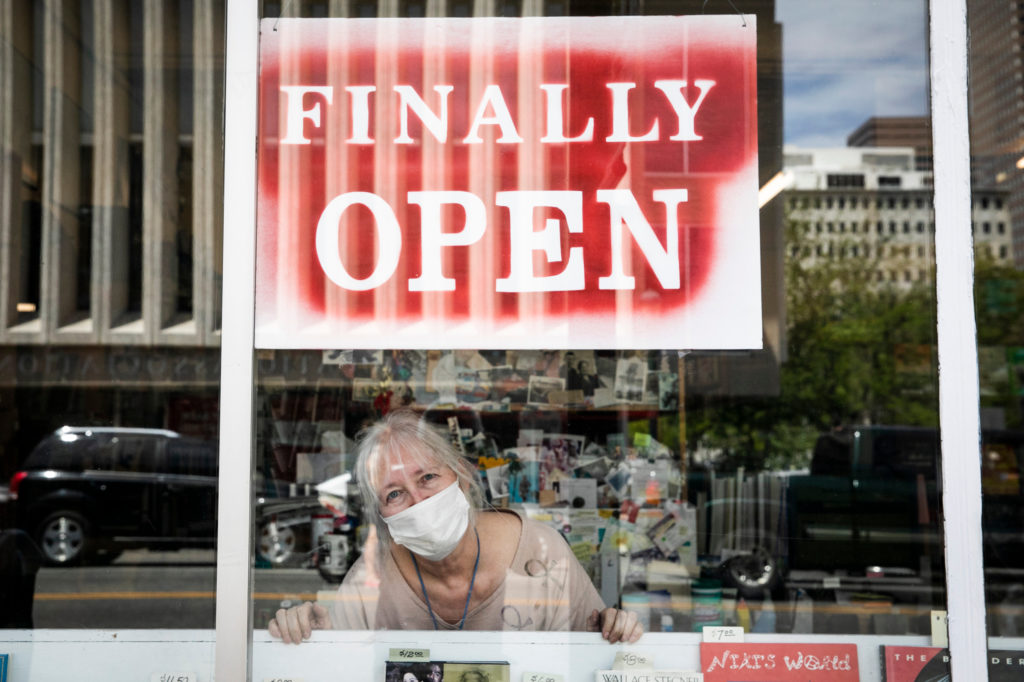 Capitol Hill Books owner Holly Brooks in her reopened store on Colfax Avenue