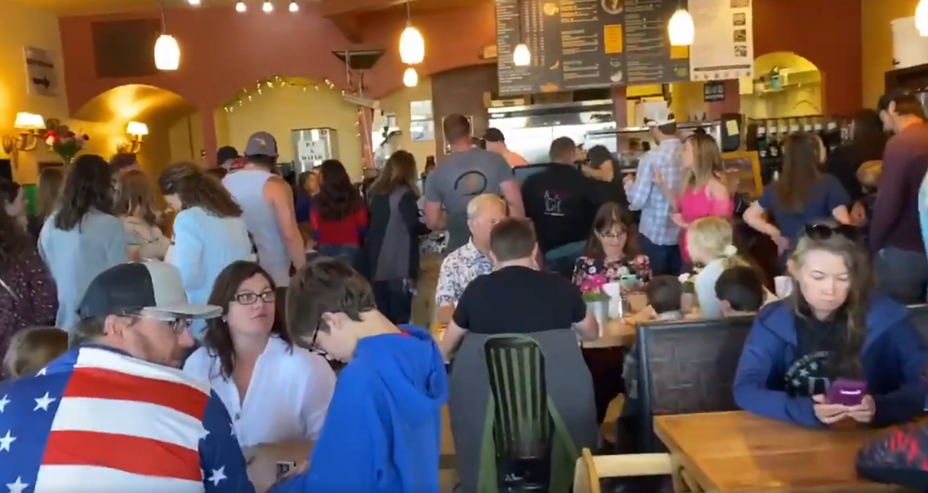 A screengrab from a Twitter video showing customers inside C&C Coffee and Kitchen in Castle Rock, Colo., on May 10, 2020