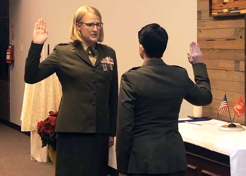 Marine judge advocate Emma Shinn (left) takes her oath of office from Maj. Rebecca Harvey in 2019.