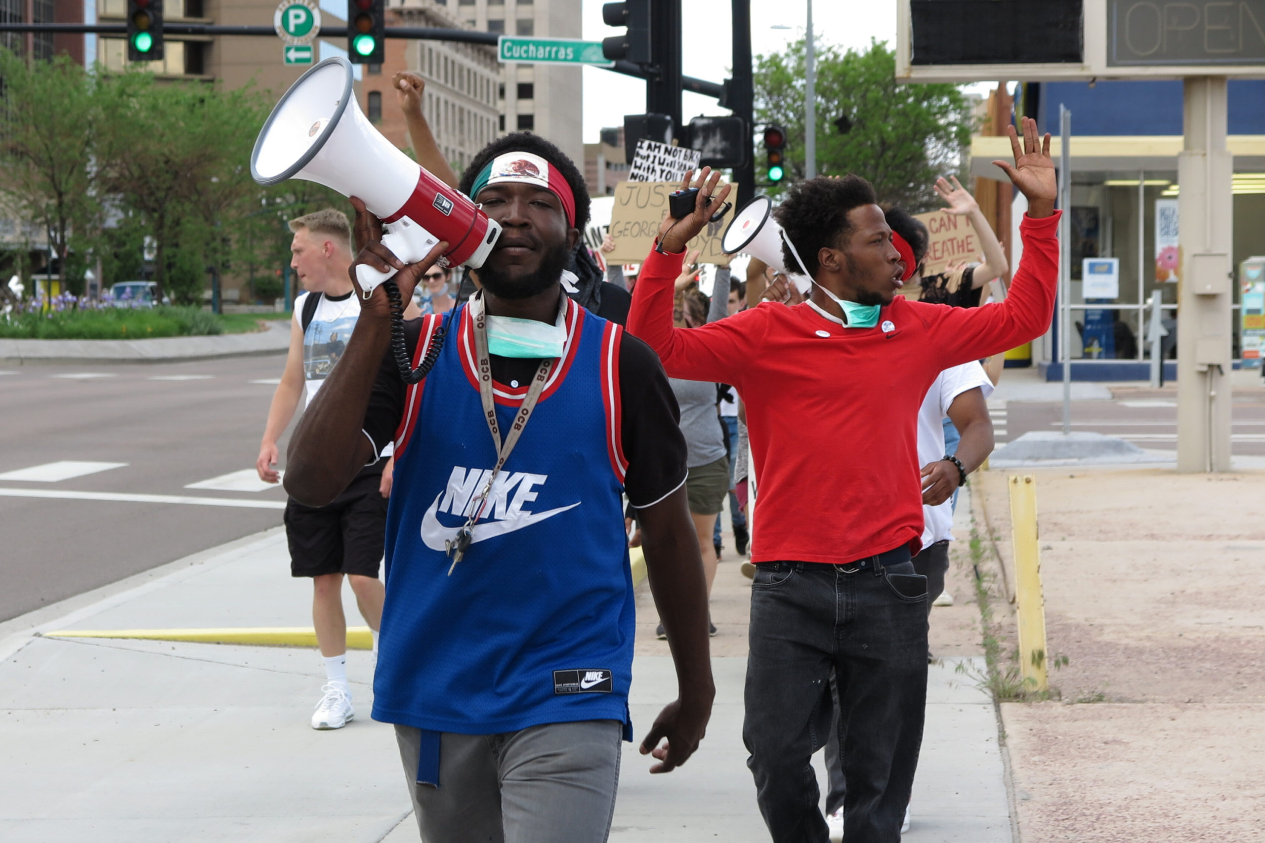 An organizer leads protesters toward the Colorado Springs Police Operations Center on June 1, 2020. Monday's protests were quieter after a weekend of civil unrest in the state's second-largest city.