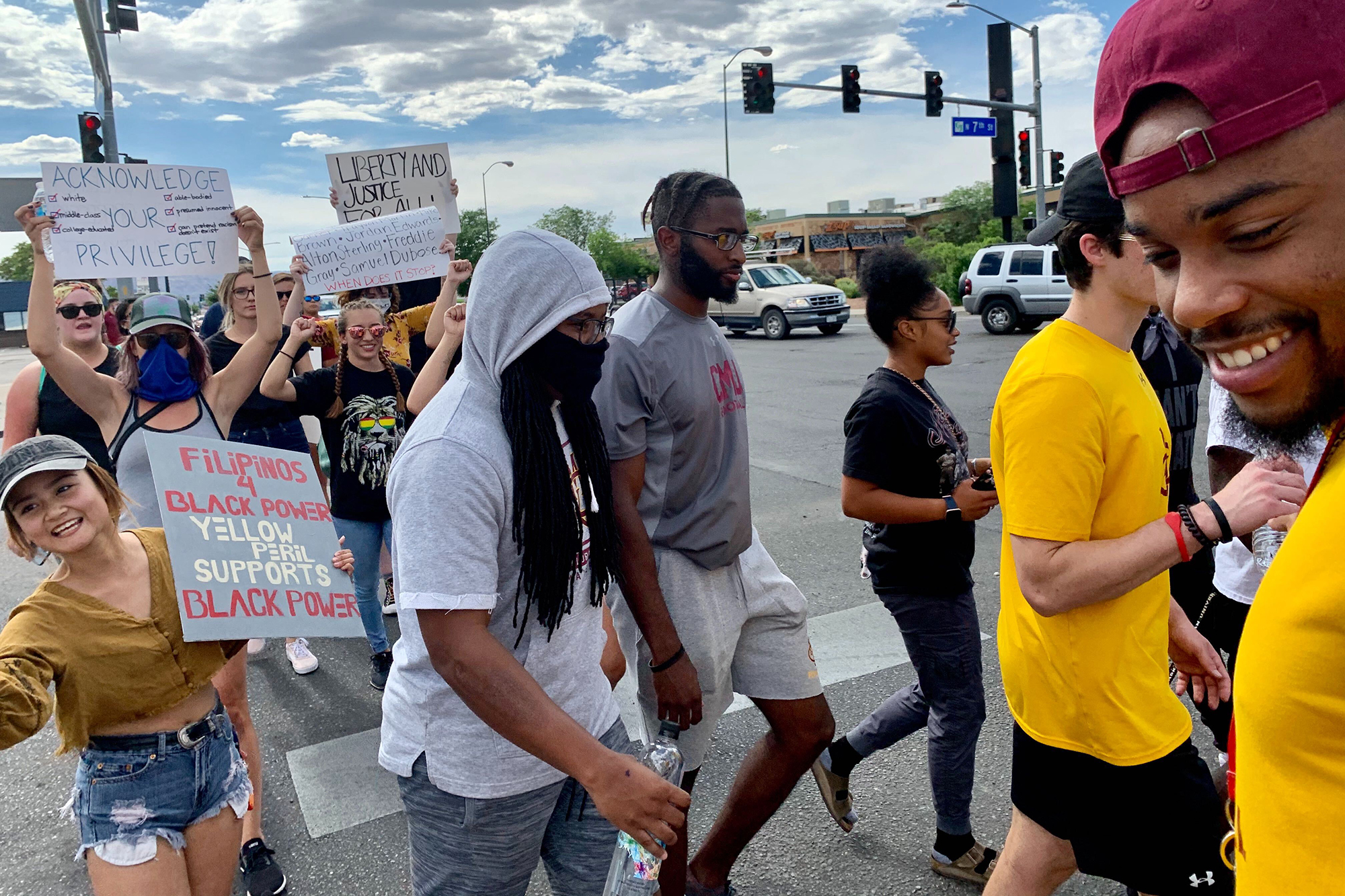 Protesters, including many Colorado Mesa University students, march in Grand Junction in a demonstration against the death of George Floyd and police brutality on Monday, June 1, 2020.