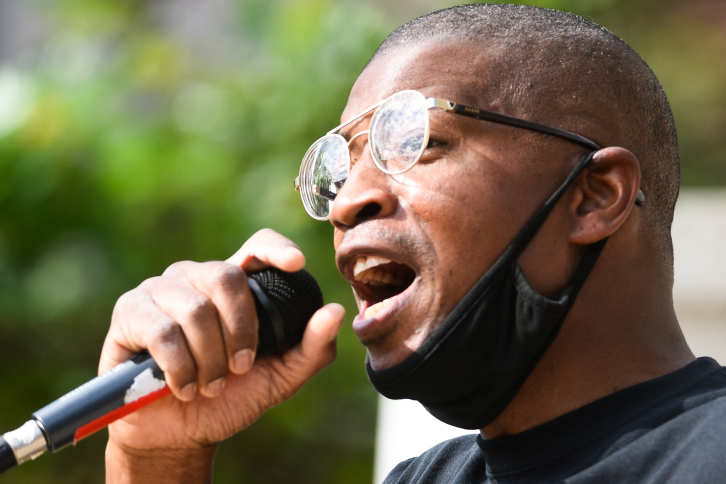 Kevin Mitchell, a community organizer, speaking at a protest event on Thursday, June 11.