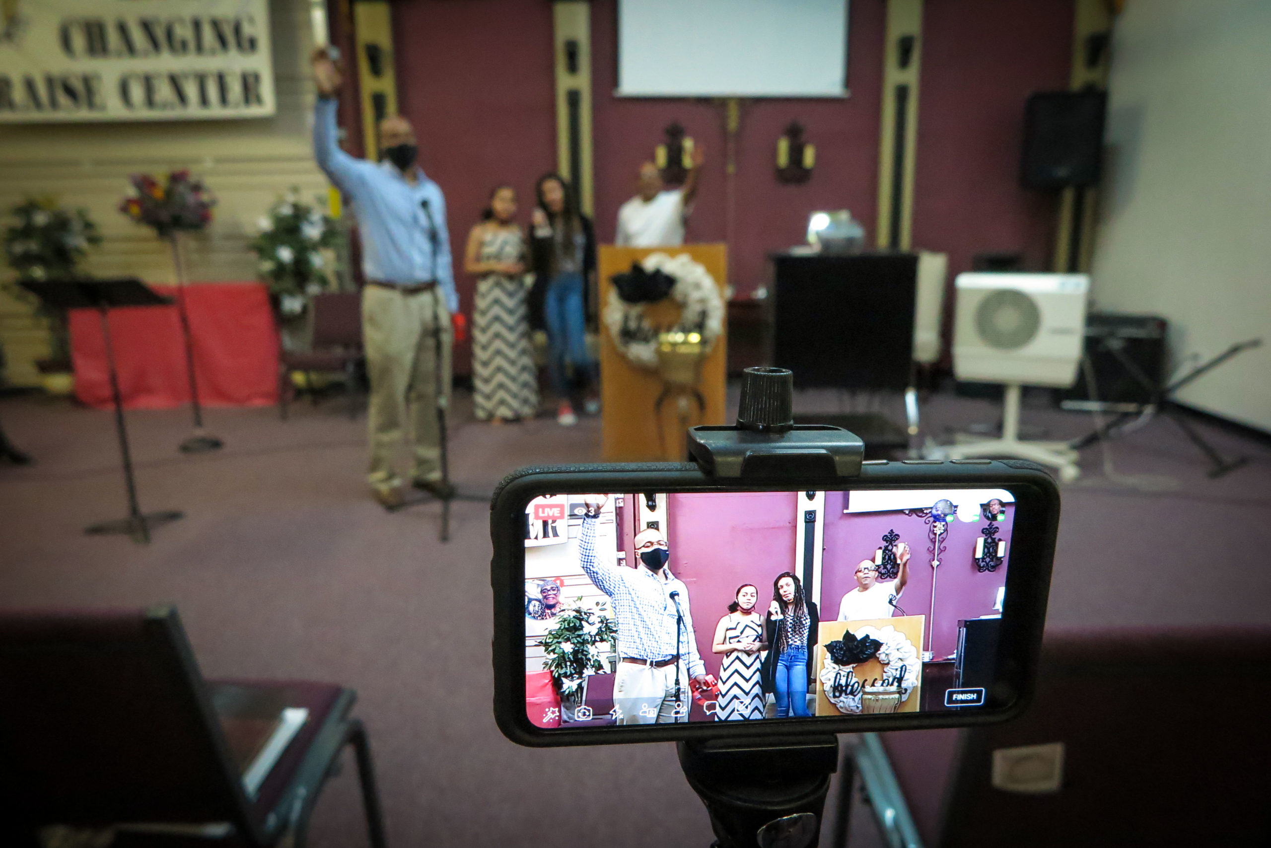 Pastor Terry Thomas (right) has started in-person services at his Lifting up Jesus church for the first time since the start of the coronavirus pandemic.