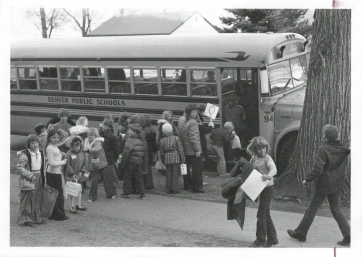 Students stand in line waiting to board the bus as part of the Denver Public Schools desegregation busing system circa 1970.