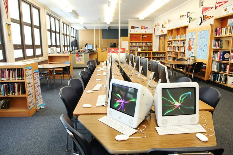 An empty bank of computers at Grant Beacon Middle School in Denver. School officials would like to ensure every child has access to a computer device and the internet at home in case schools must return to remote learning or a hybrid model.
