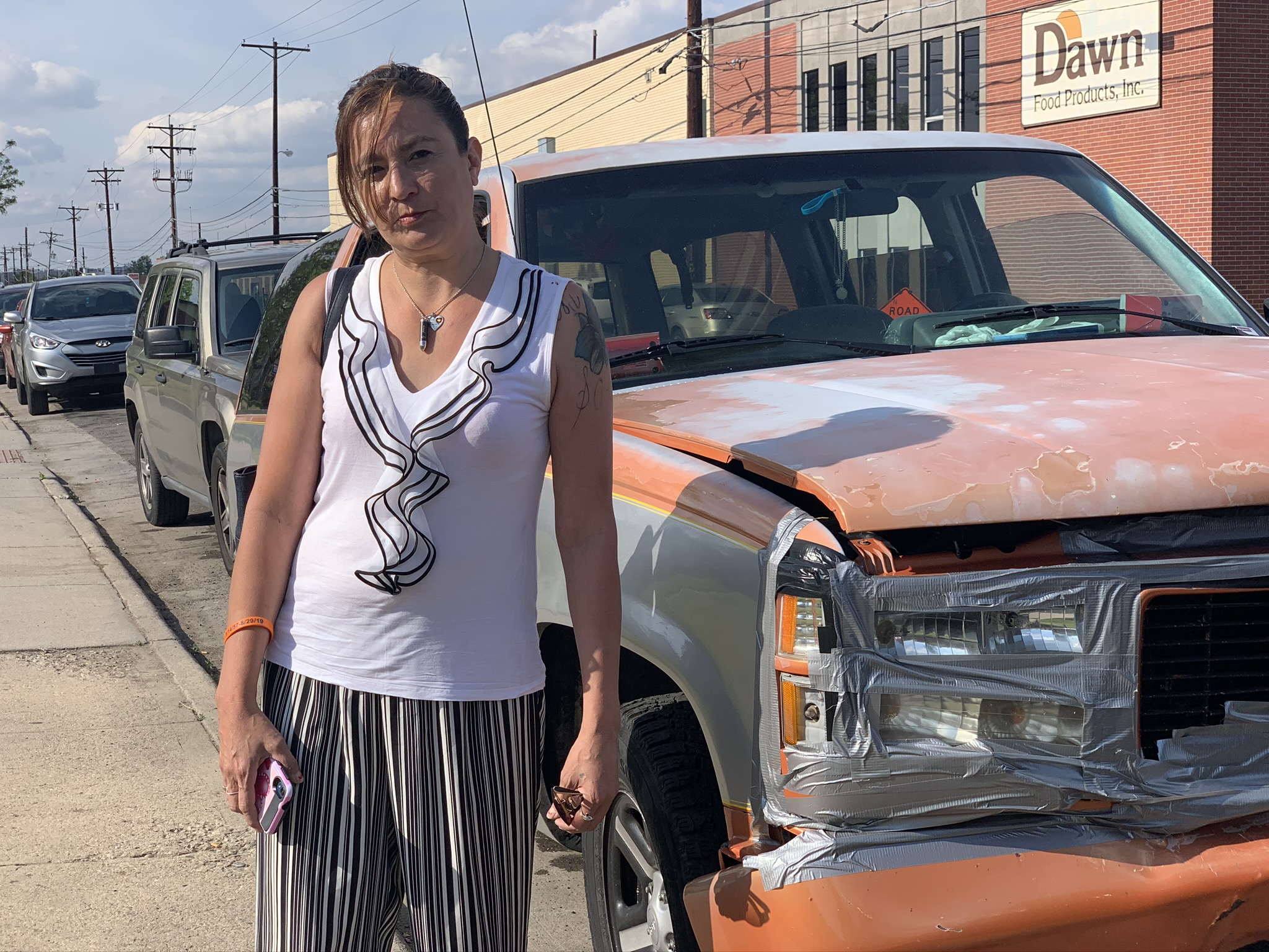 Tiffany Quintana poses for a photo on May 28 in the Sunnyside neighborhood of Denver, near the vehicle where she lived for several weeks.