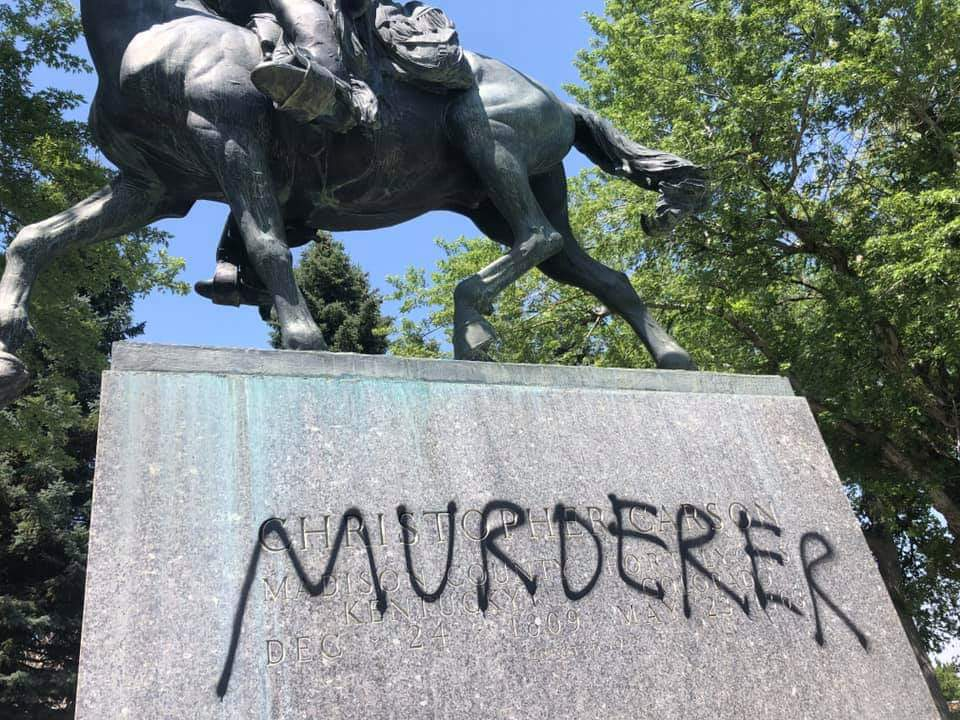 """Someone spray painted the word """"murderer"""" on the base of a Kit Carson statue in Trinidad, Colo."""