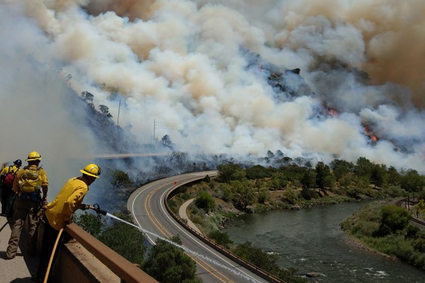 Firefighters face off against the Grizzly Creek fire in Glenwood Canyon.