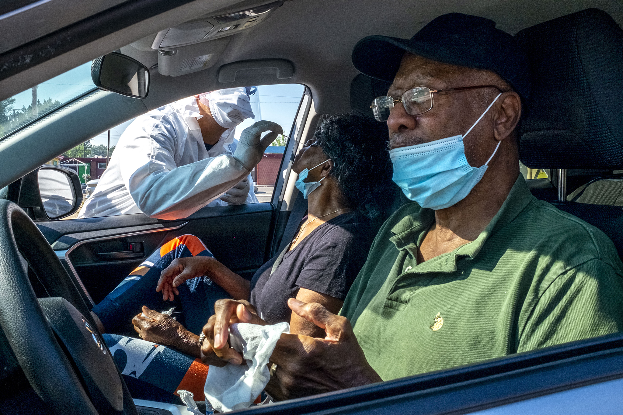 Jose Silva helps George and Barbara Goree get a COVID-19 test at  the Center for African American Health in Denver's Northeast Park Hill neighborhood. Aug. 14, 2020.