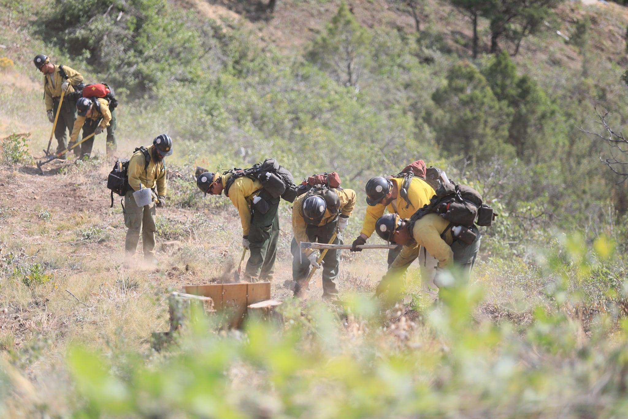 Crews work near the Adventure Park outside Glenwood Springs, to slow the growth of the Grizzly Creek Fire.