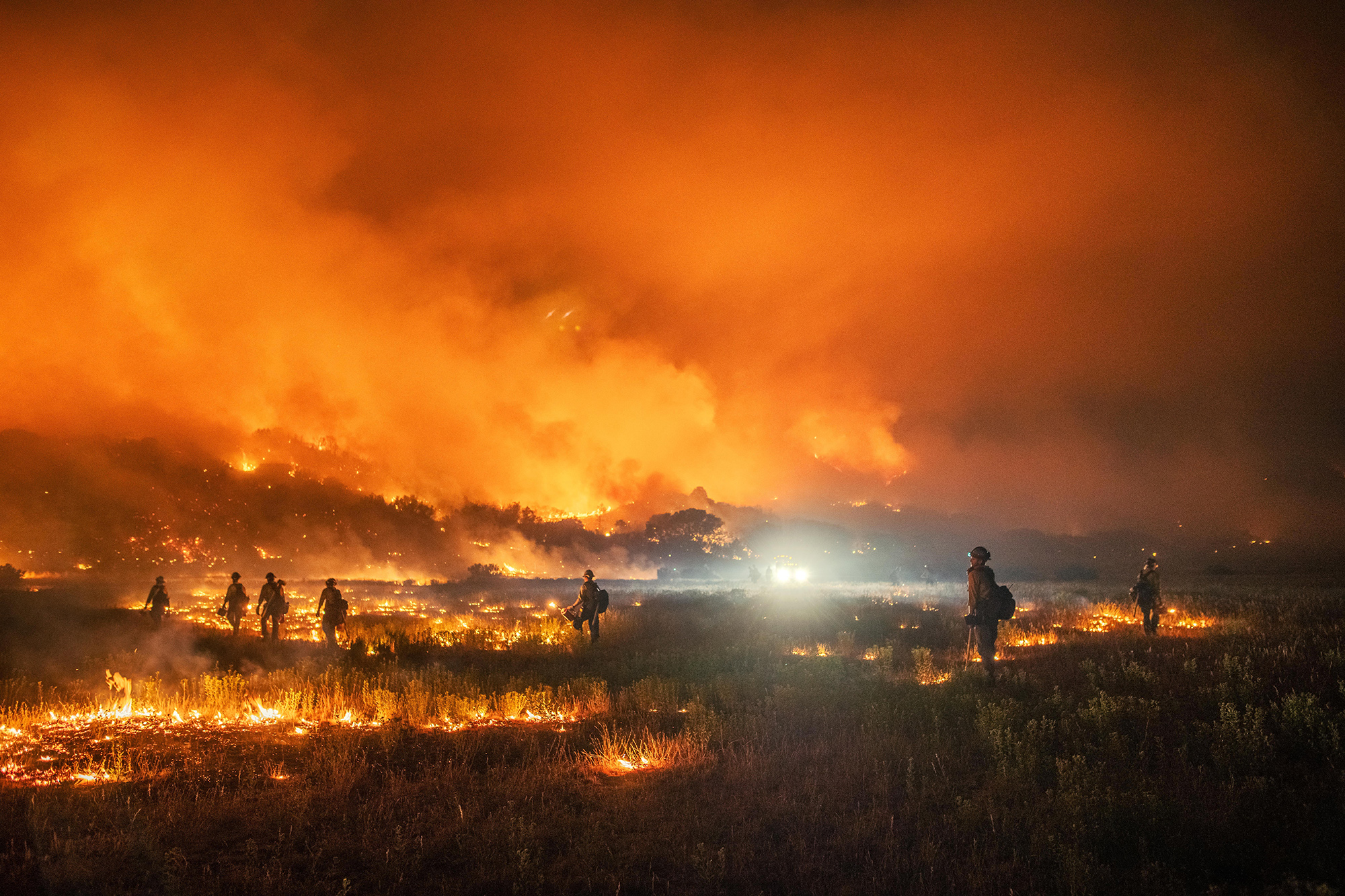Firefighters at work on the Pine Gulch fire during the night shift.