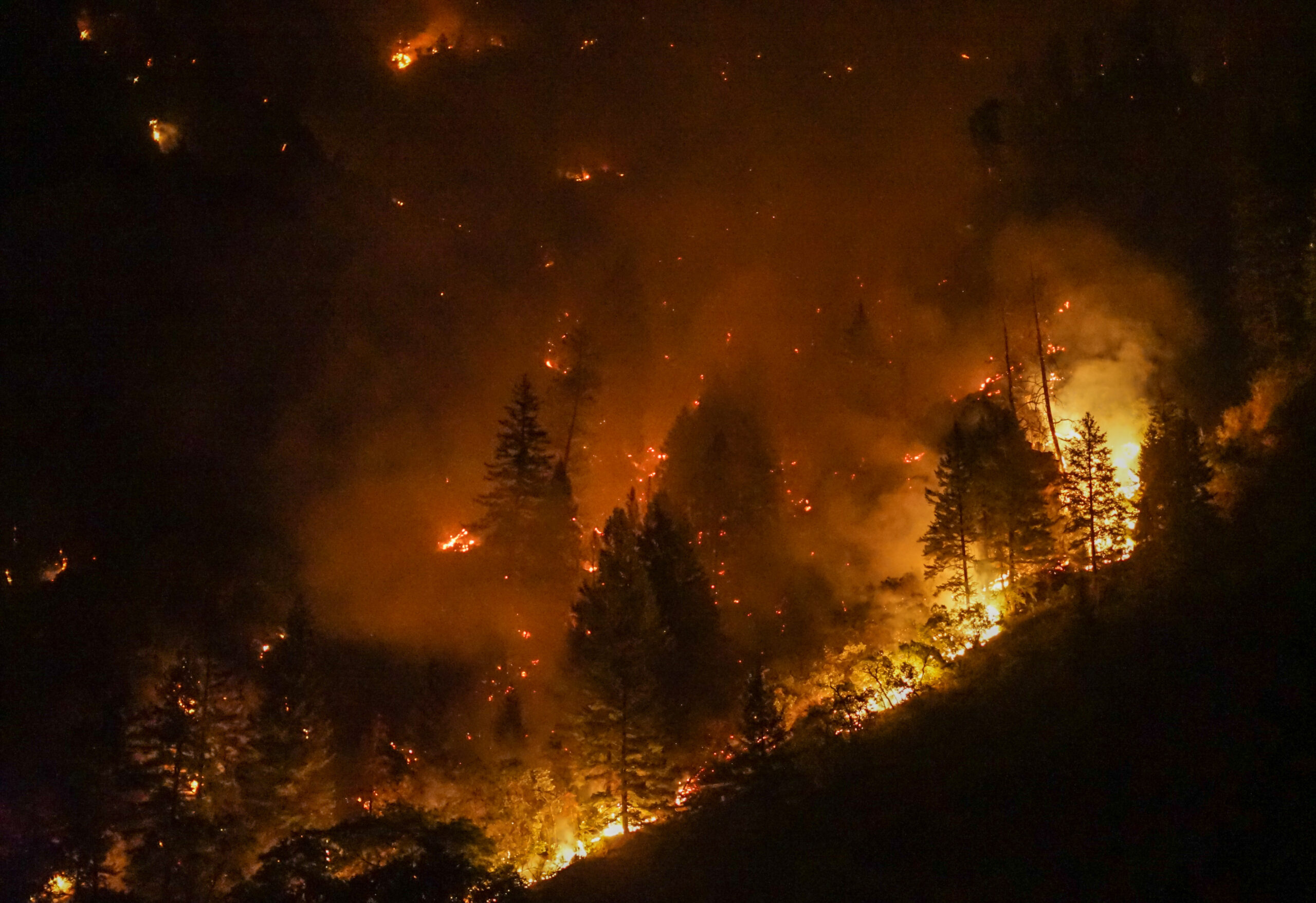 "The Grizzly Creek fire's ""active behavior"" is seen the night of Aug. 13, 2020."