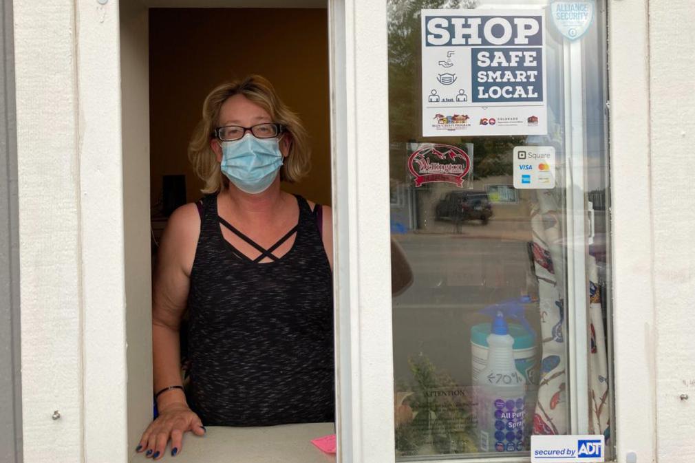 Wellington native Linda Knaack helps customers through this window at her family-run auto repair shop.
