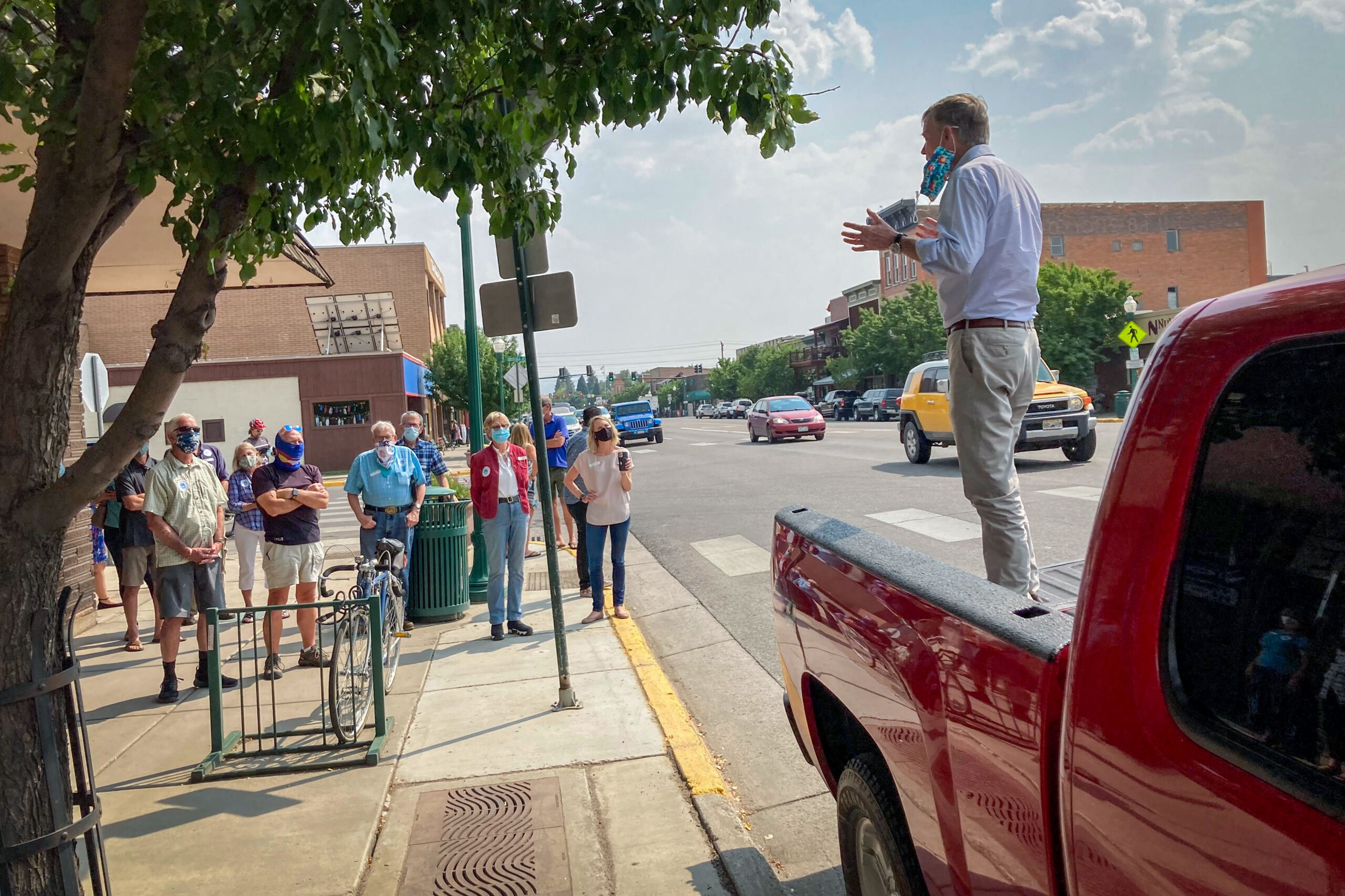 John Hickenlooper campaigns in Gunnison from a pickup truck, Saturday, Aug. 22, 2020. The former governor is challenging Sen. Cory Gardner for his seat.