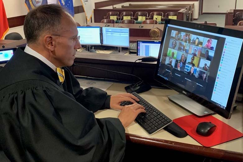 Hillsborough, Fla. County Circuit Judge Michael Scionti presides over a virtual Veterans Treatment Court session on Zoom.