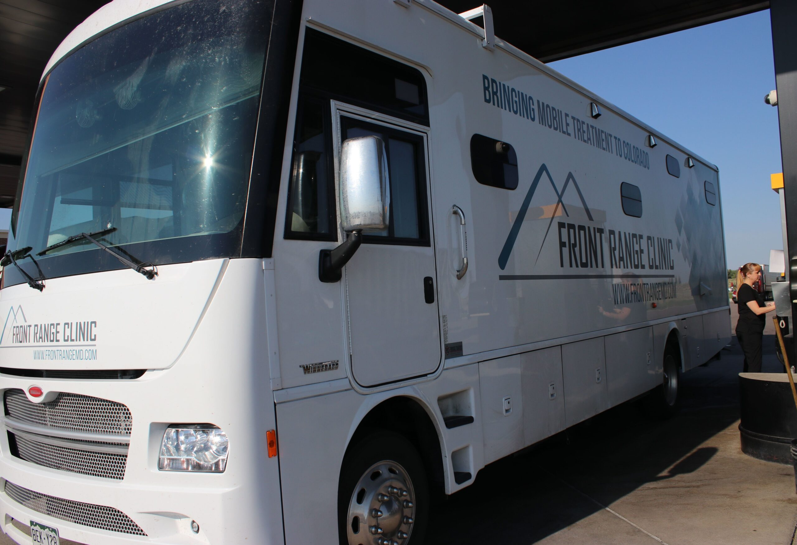 "Each mobile clinic has a nurse, a counselor and a peer specialist — all trained to drive a 34-foot-long motor home. ""I never thought when I went to nursing school that I'd be doing this,"" says Christi Couron, as she pumps 52 gallons of diesel fuel into the vehicle."