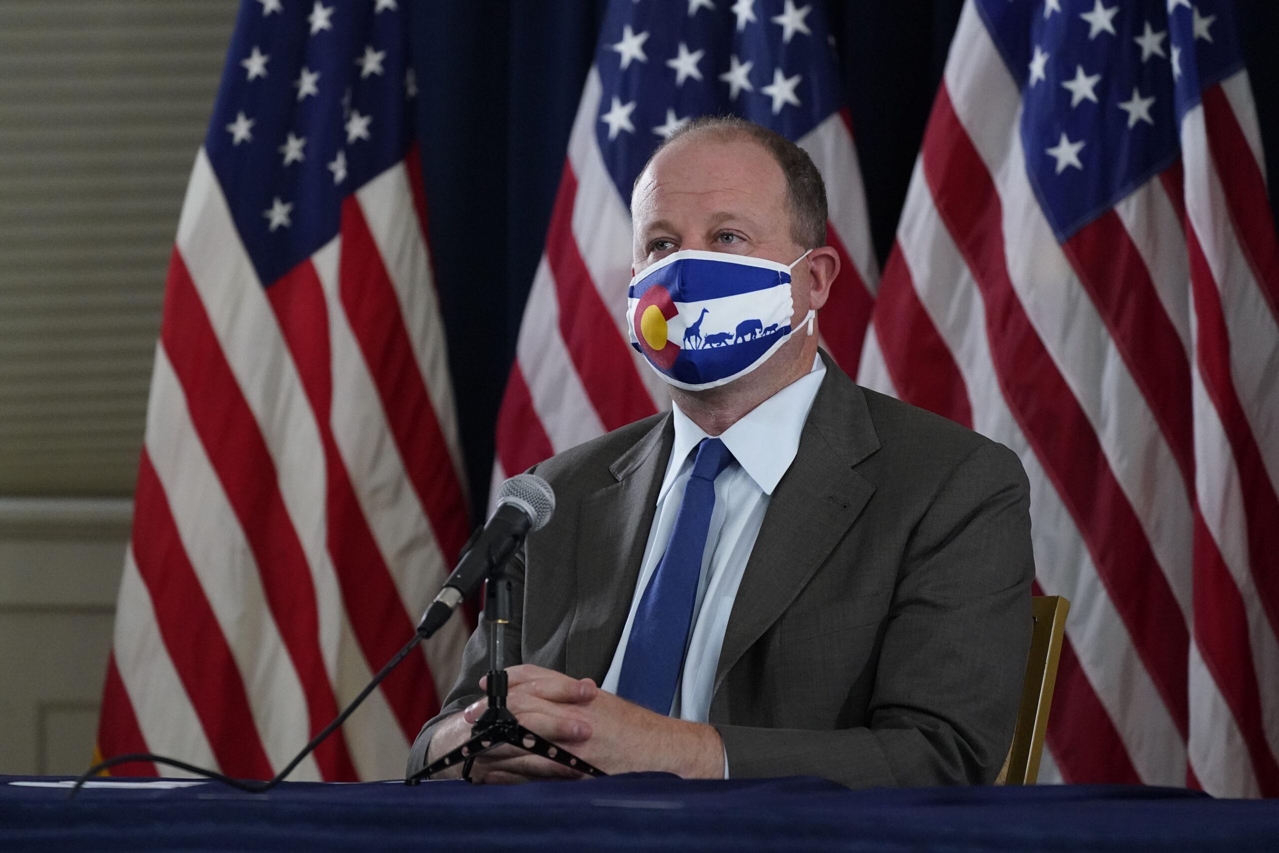 Colorado Gov. Jared Polis in a face mask.