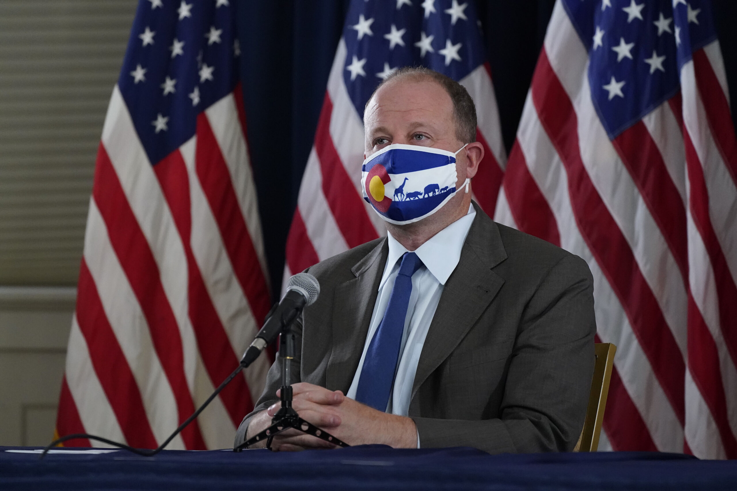 Colorado Gov. Jared Polis in a face mask.