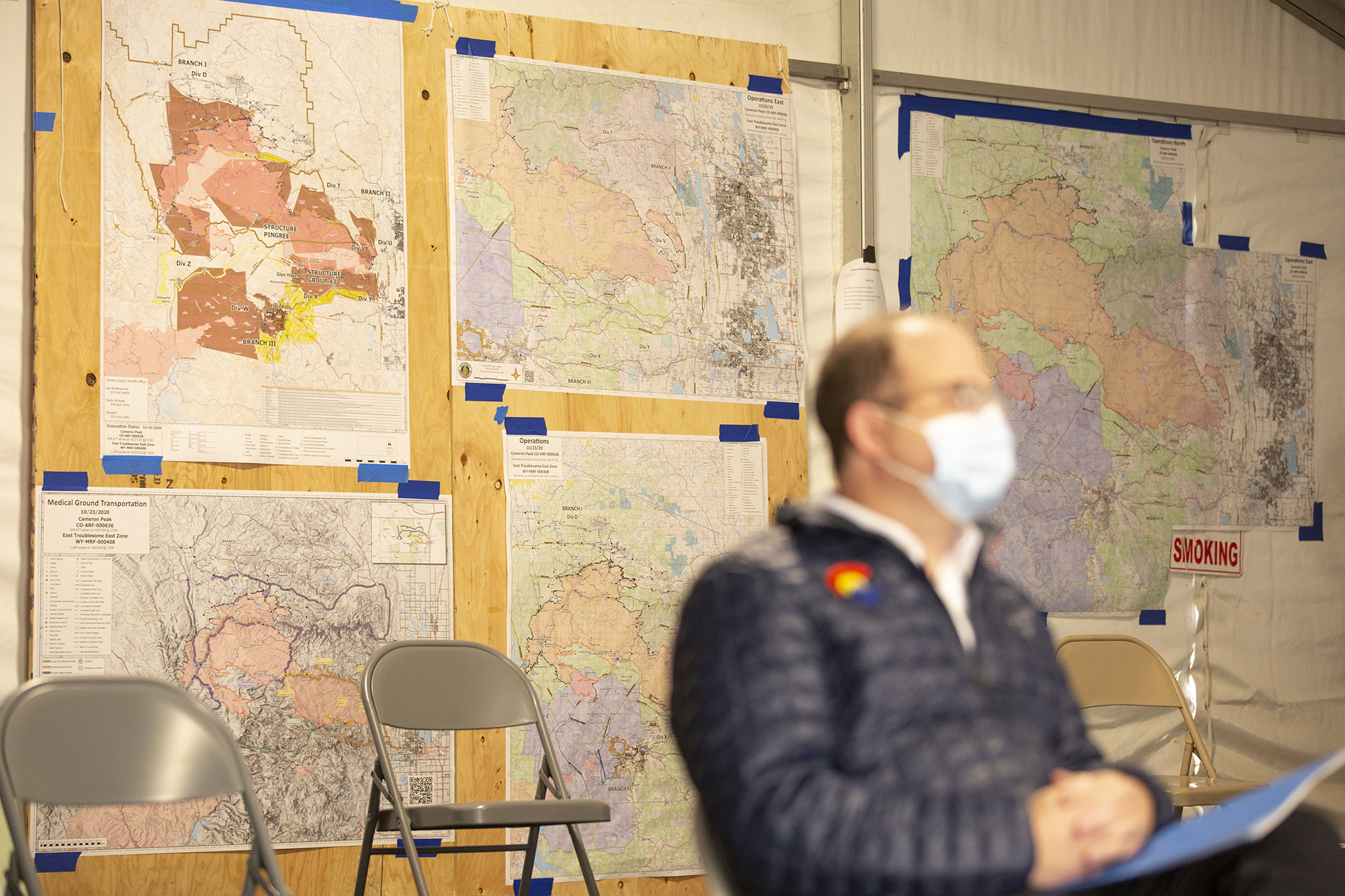 Gov. Jared Polis visits the Cameron Peak Fire's incident command post, just off I-25 in Loveland. Oct. 23, 2020.