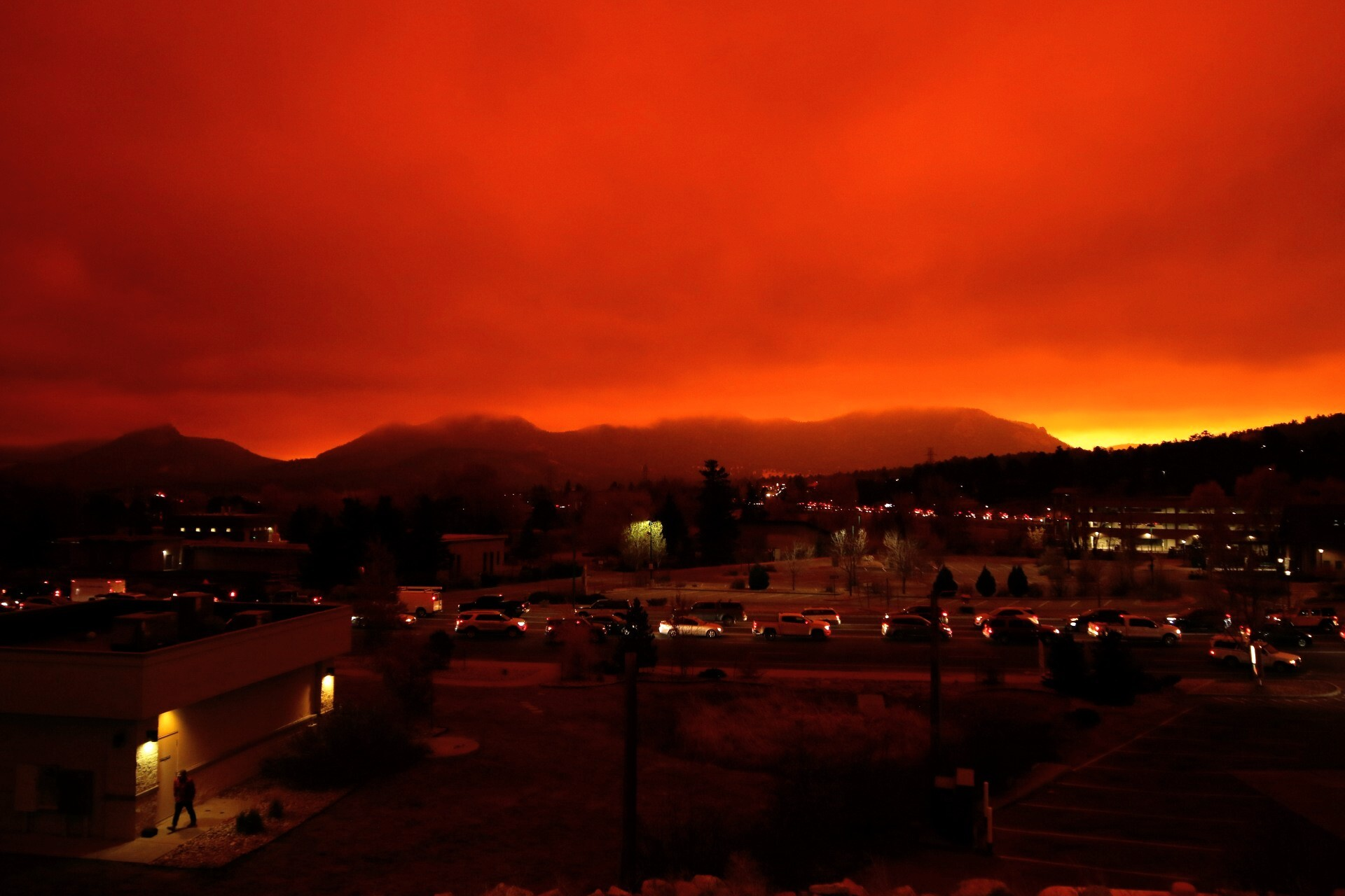 Smoke and ash from the nearby East Troublesome and Cameron Peak fires loom over Estes Park, where there are mandatory evacuation orders. Oct. 22, 2020.