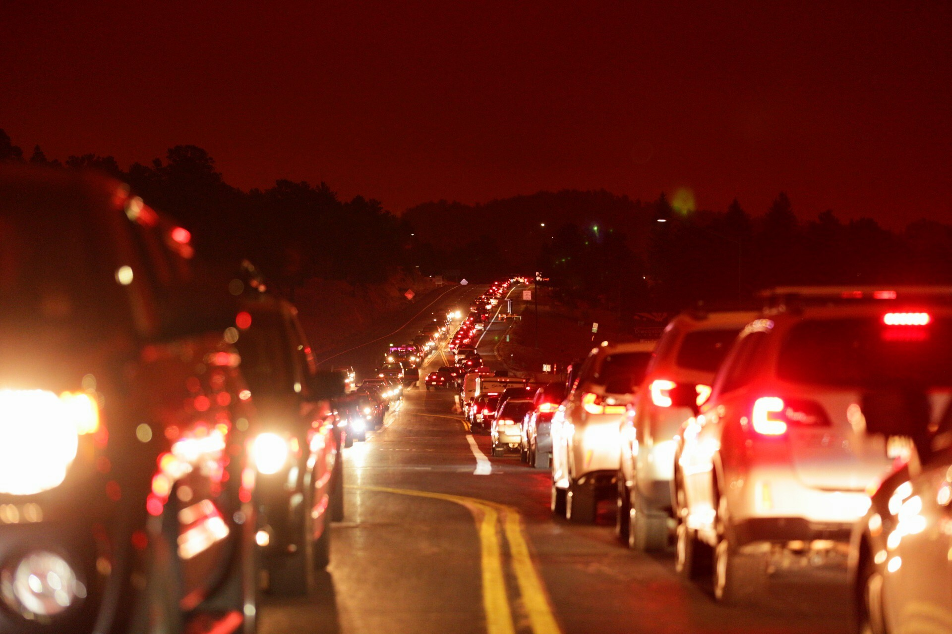 At 2:15 p.m. in the afternoon, it's dark as night — and traffic is at a standstill — as people evacuate Estes Park. Much of the town is under mandatory evacuation orders from the nearby Cameron Peak and East Troublesome fires. Oct. 22, 2020.