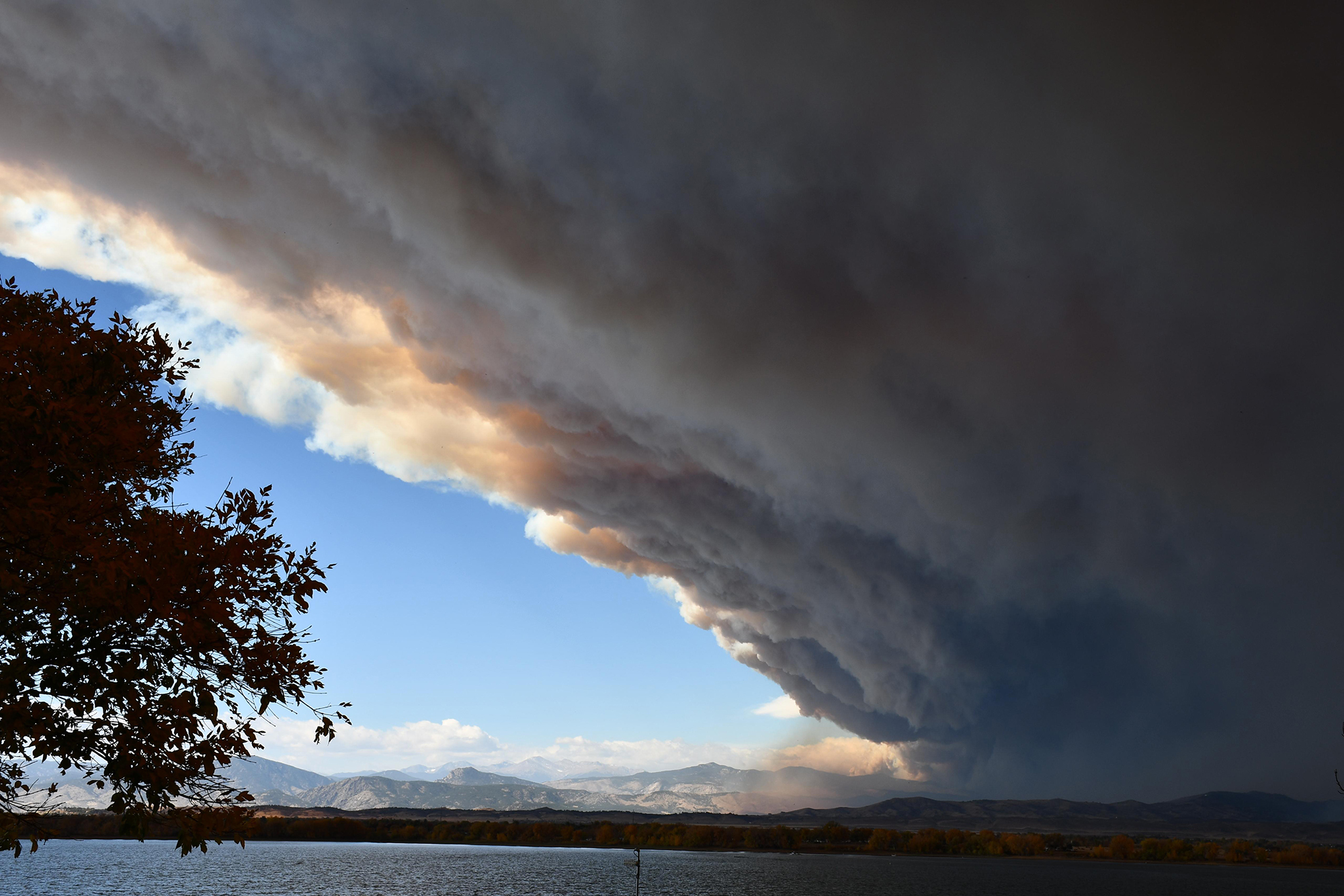 Smoke from the Cameron Peak fire seen from Boyd Lake. The fire burned aggressively Wednesday morning due to very high winds.