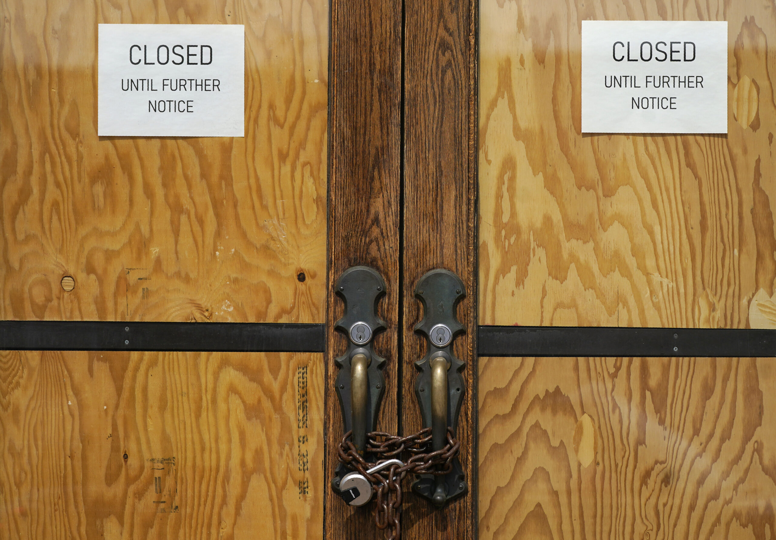The front doors of a closed restaurant