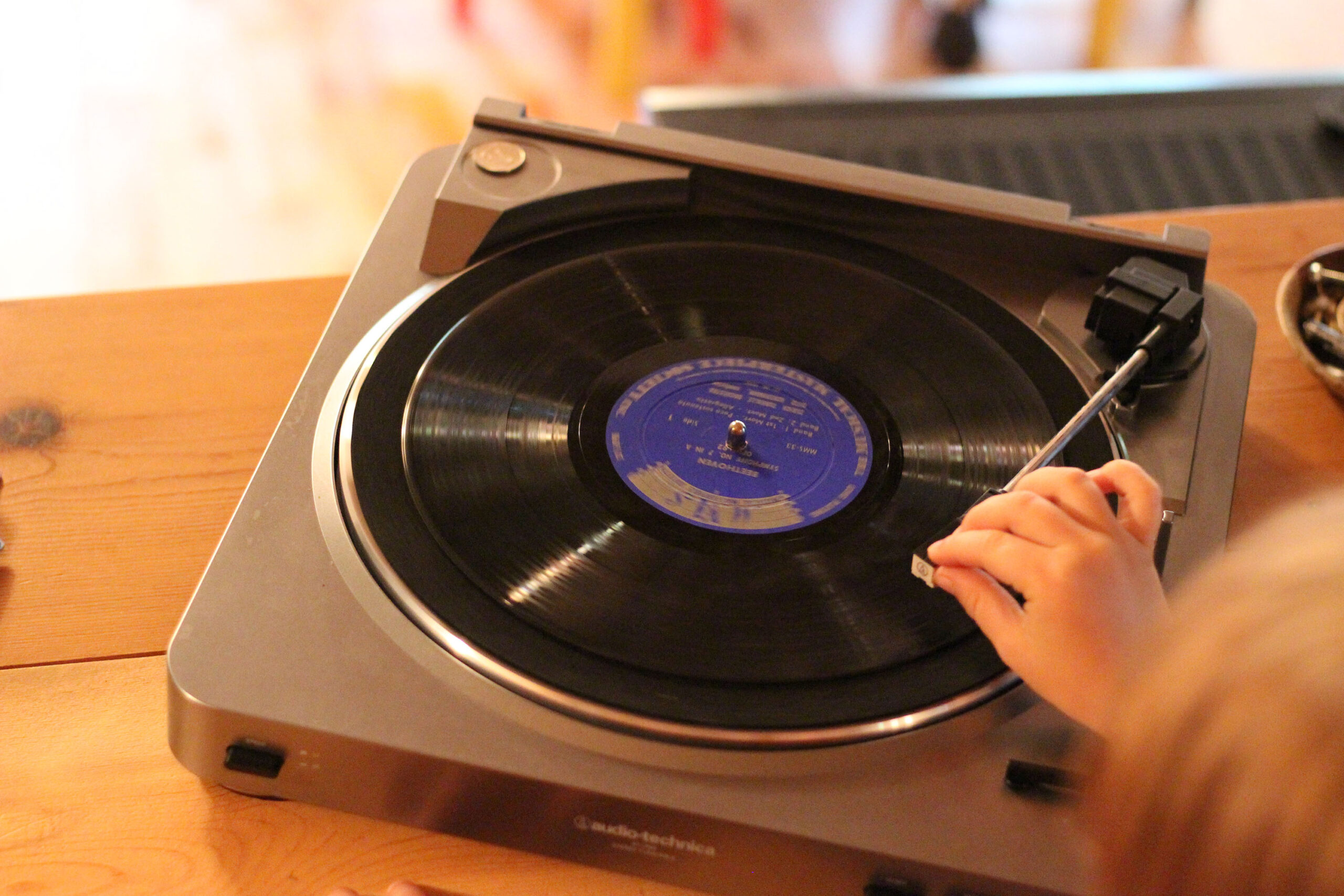 record player with child's hands music