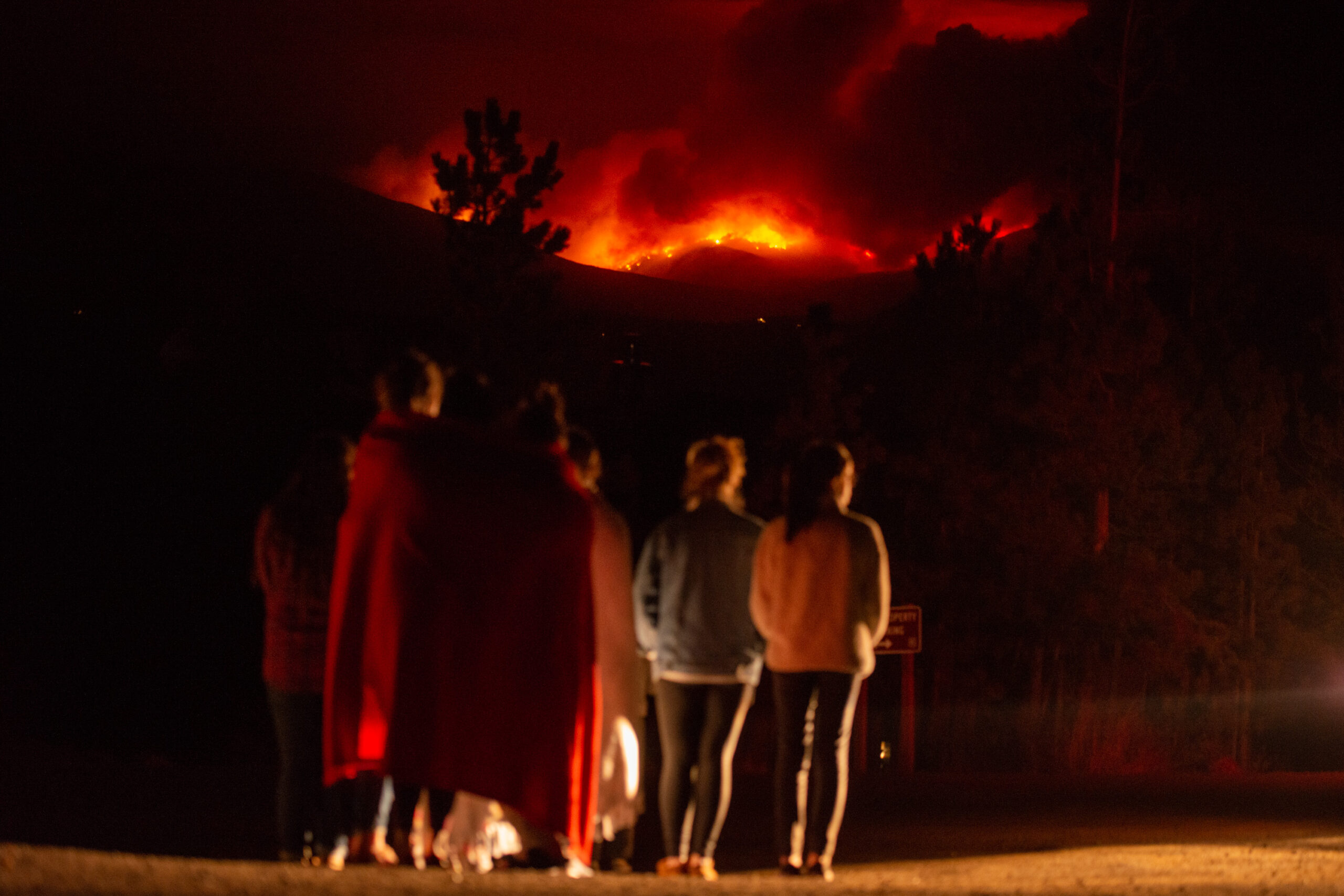 Onlookers watch the Cameron Peak fire from Pole Hill Road as it burns north of Estes Park on Wednesday, Oct. 14, 2020.