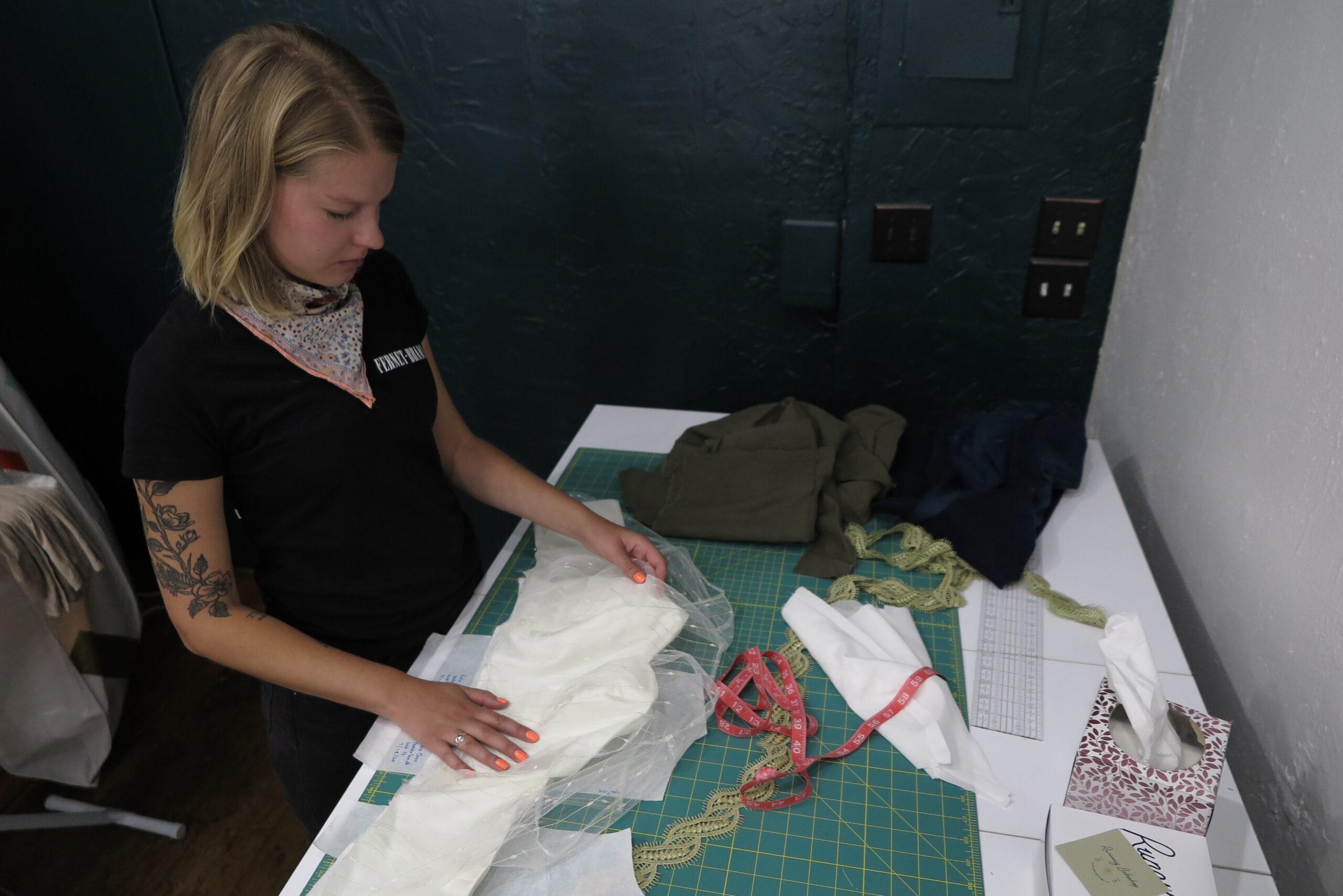 Rebecca Moon works on a custom wedding ensemble in her Colorado Springs store, Moonbeam Clothiers.