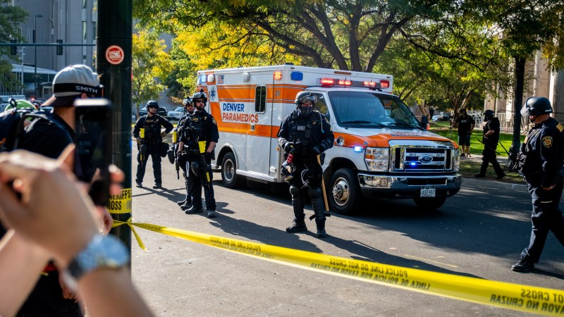 "An ambulance leaves the scene after a soup drive and ""anti-fascist"" protest clashed with pro-police ""patriot"" protestors, ending in one person being shot on October 10, 2020 at Civic Center Park."