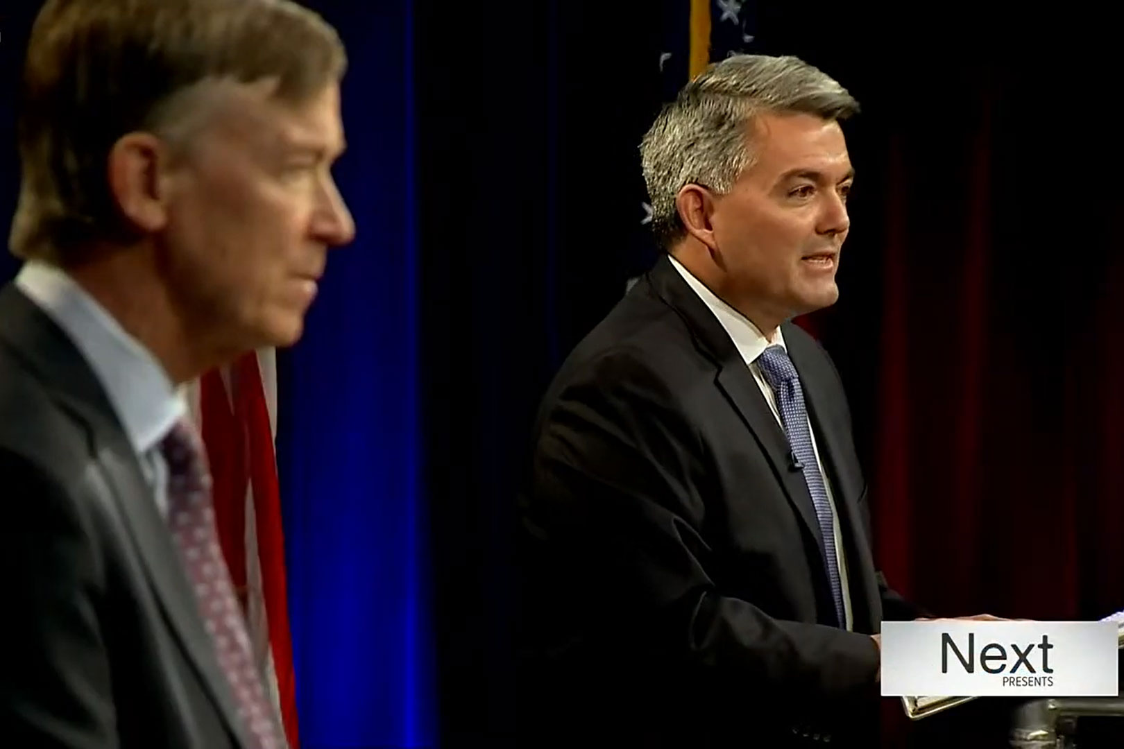 Sen. Cory Gardner and former Gov. John Hickenlooper, foreground, debate a question regarding gun laws in their final debate hosted by 9News at Colorado State University in Fort Collins, Oct. 13, 2020.