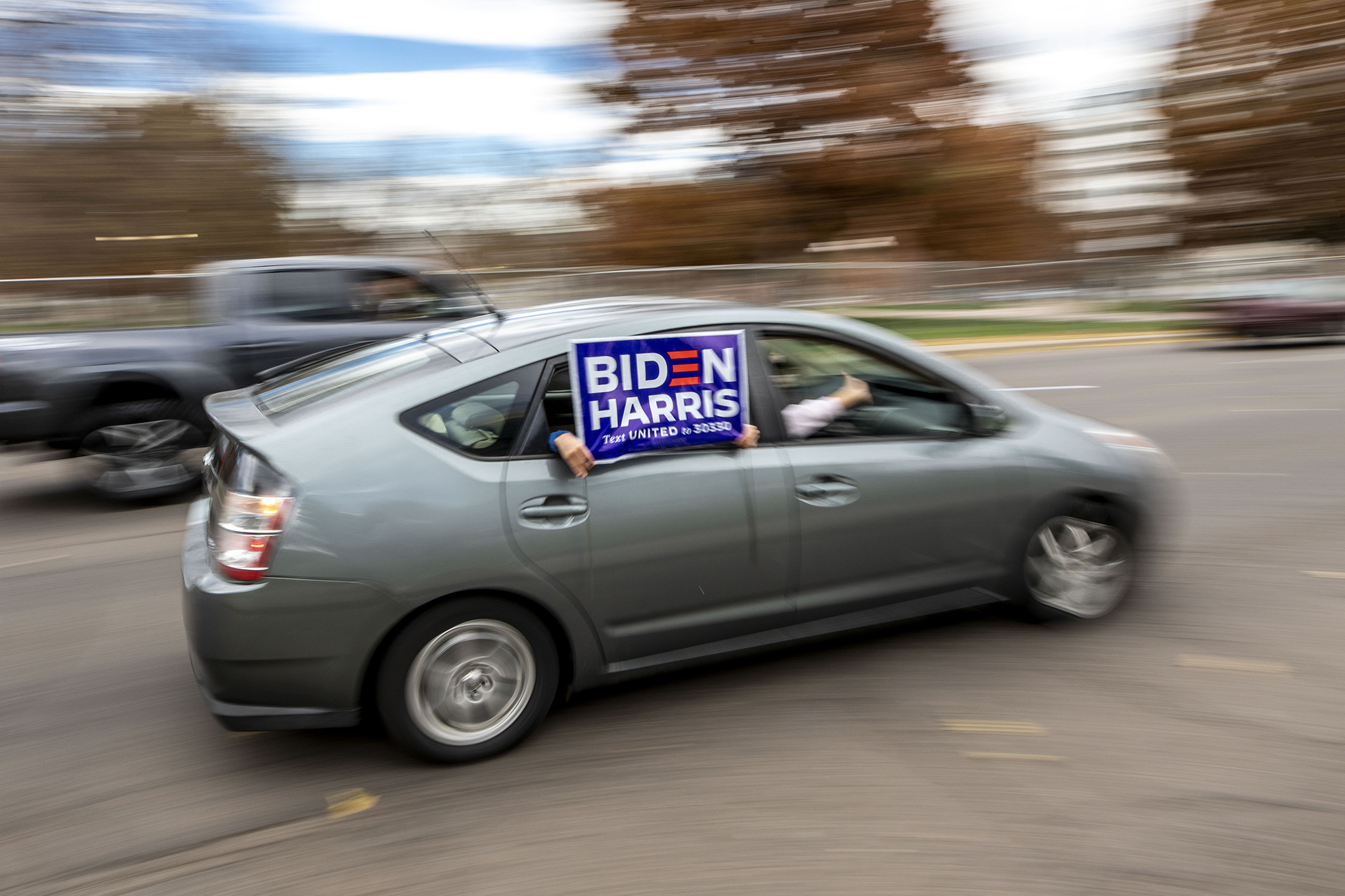People driving around the Capitol honk and cheer in celebrattion of Joe Biden's victory in the U.S. presidential election. Nov. 7, 2020.