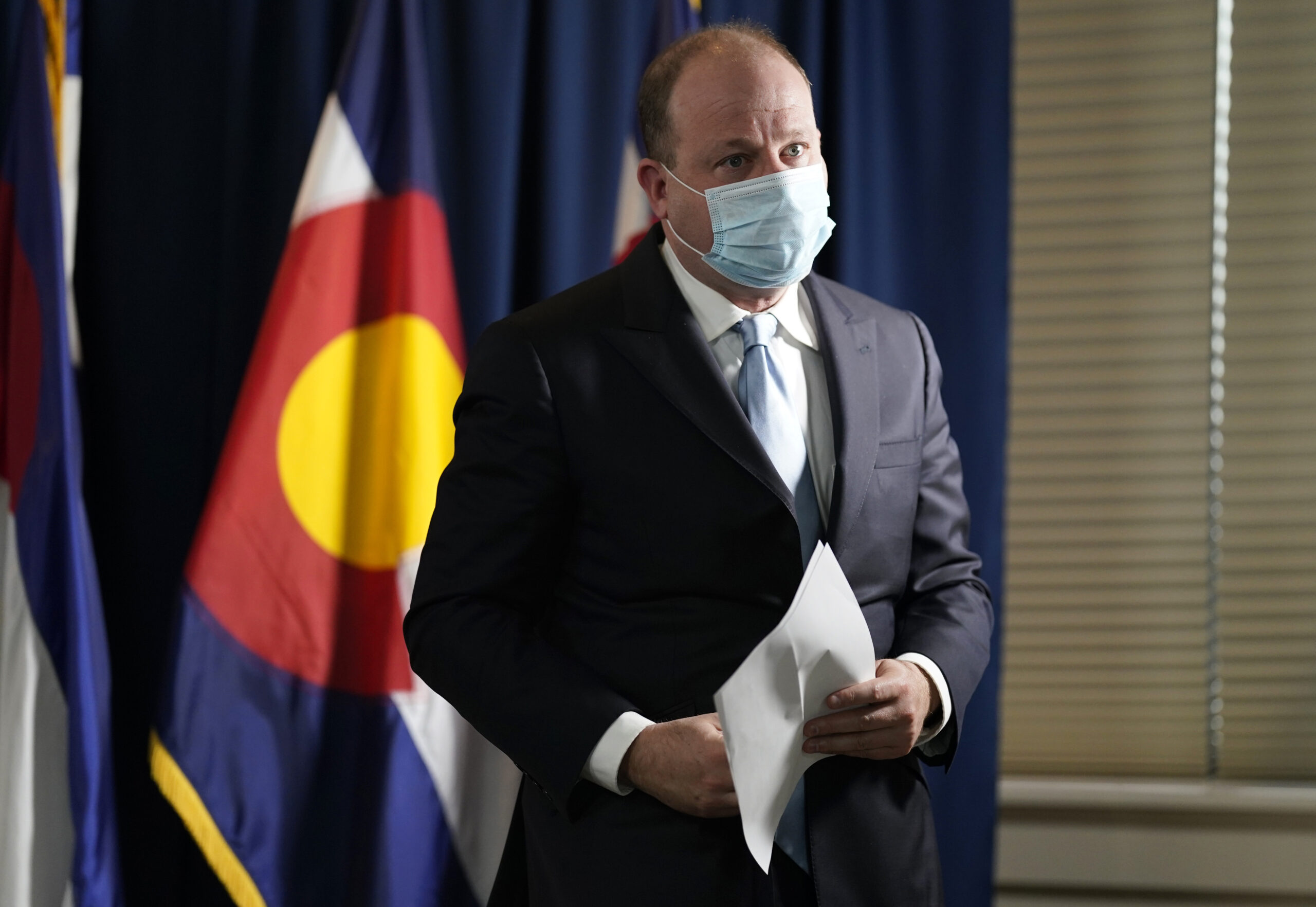 Gov. Jared Polis in a face mask.