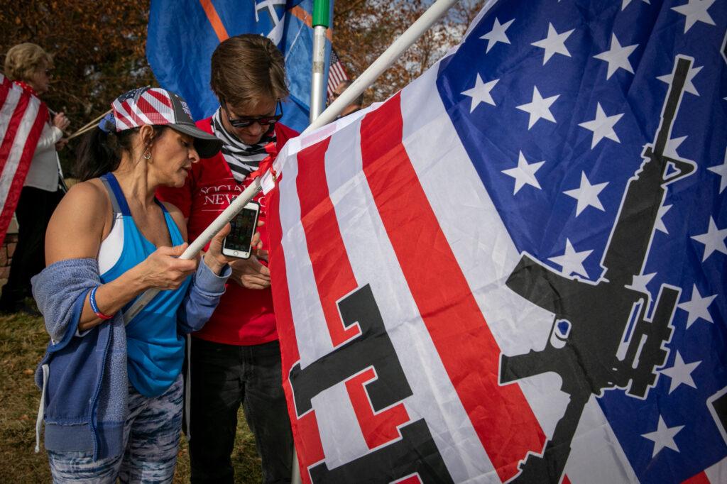 ELECTION-DAY-HIGHLANDS-RANCH-GUN-ON-FLAG