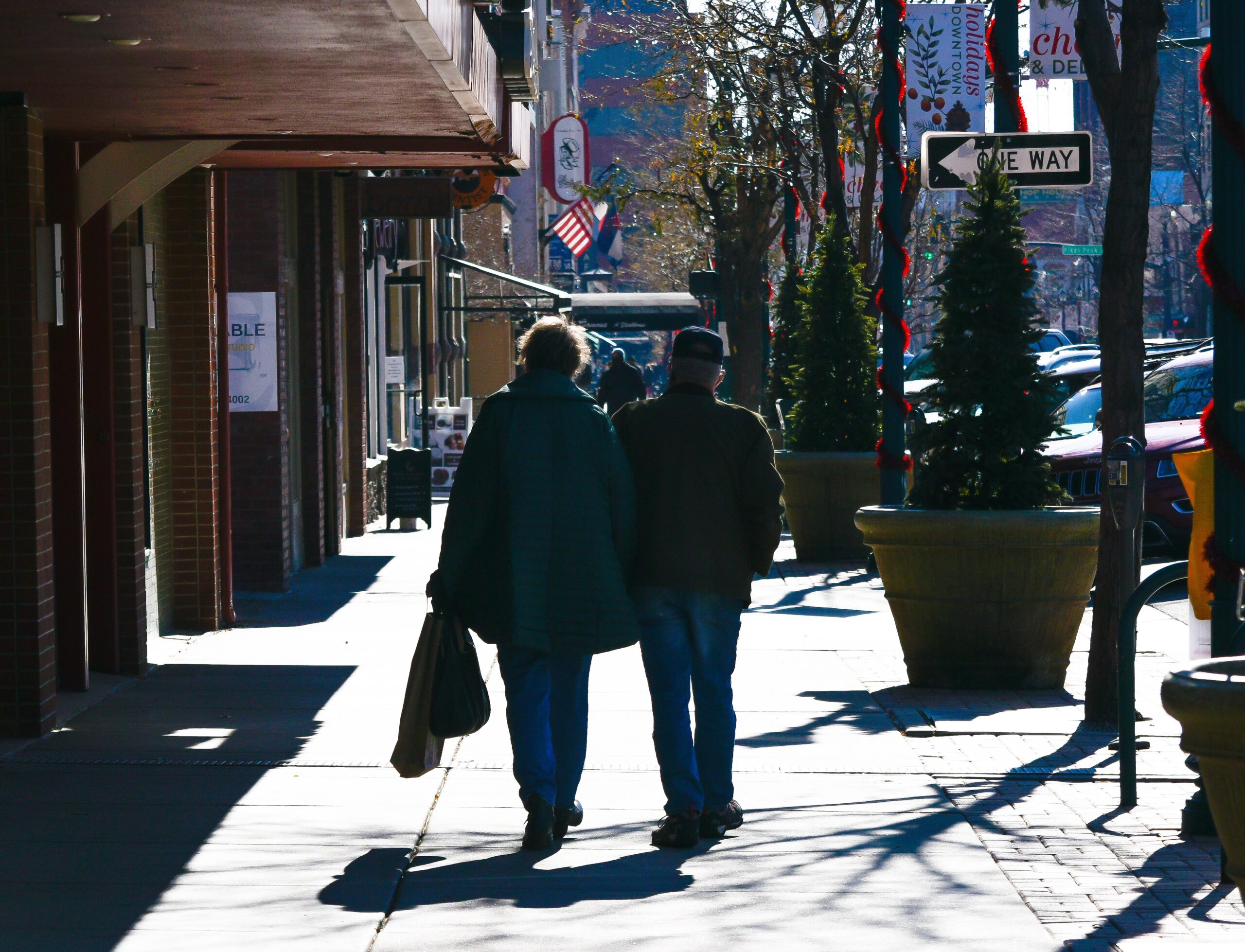 Shoppers walk down Tejon Street in downtown Colorado Springs on Black Friday.
