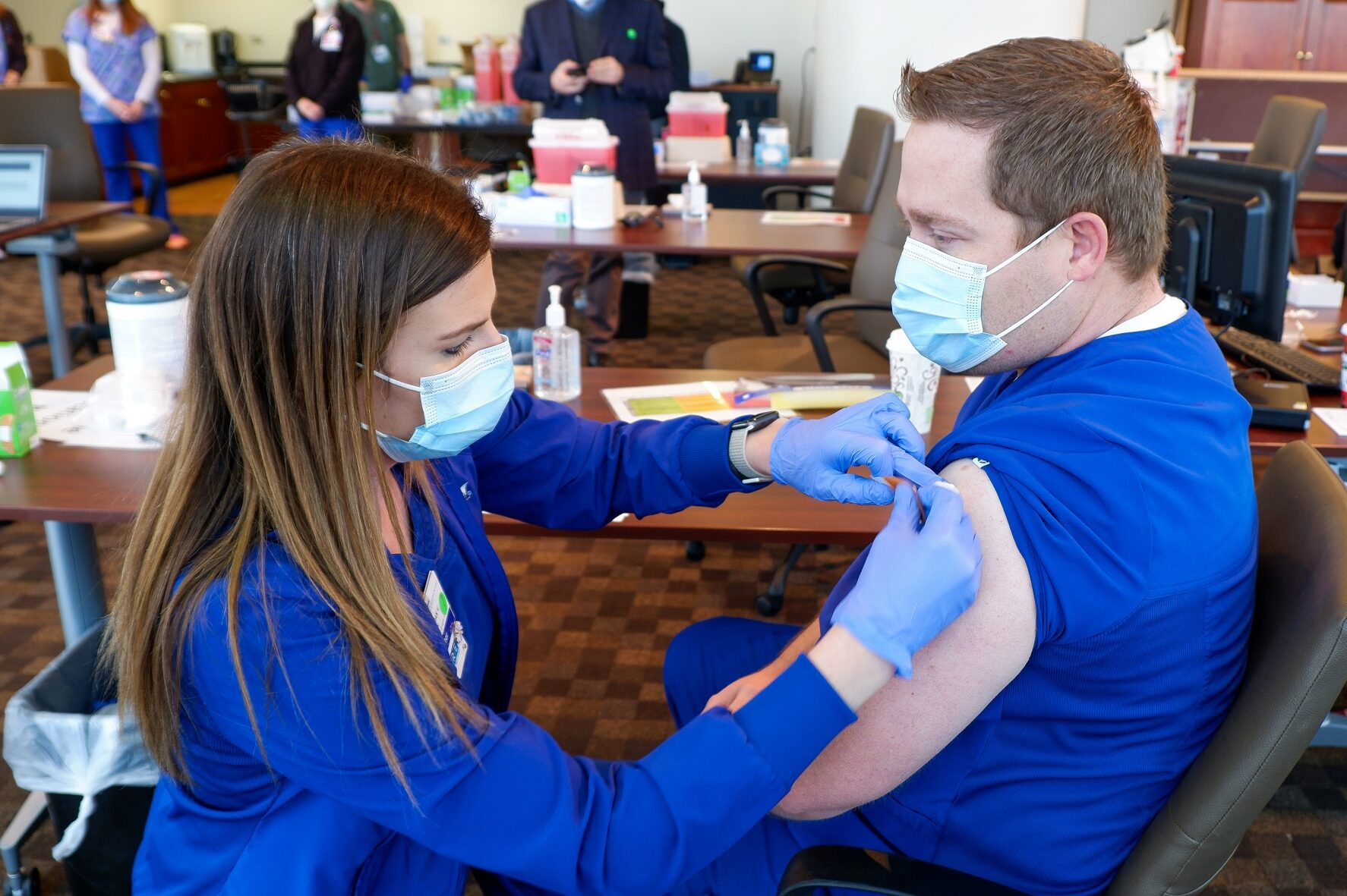 State Rep. Kyle Mullica, a Northglenn Democrat, recieves a dose of Pfizer's coronavirus vaccine on Wednesday, Dec. 16, 2020. Mullica is also an emergency room nurse who has cared for COVID-19 patients for months.