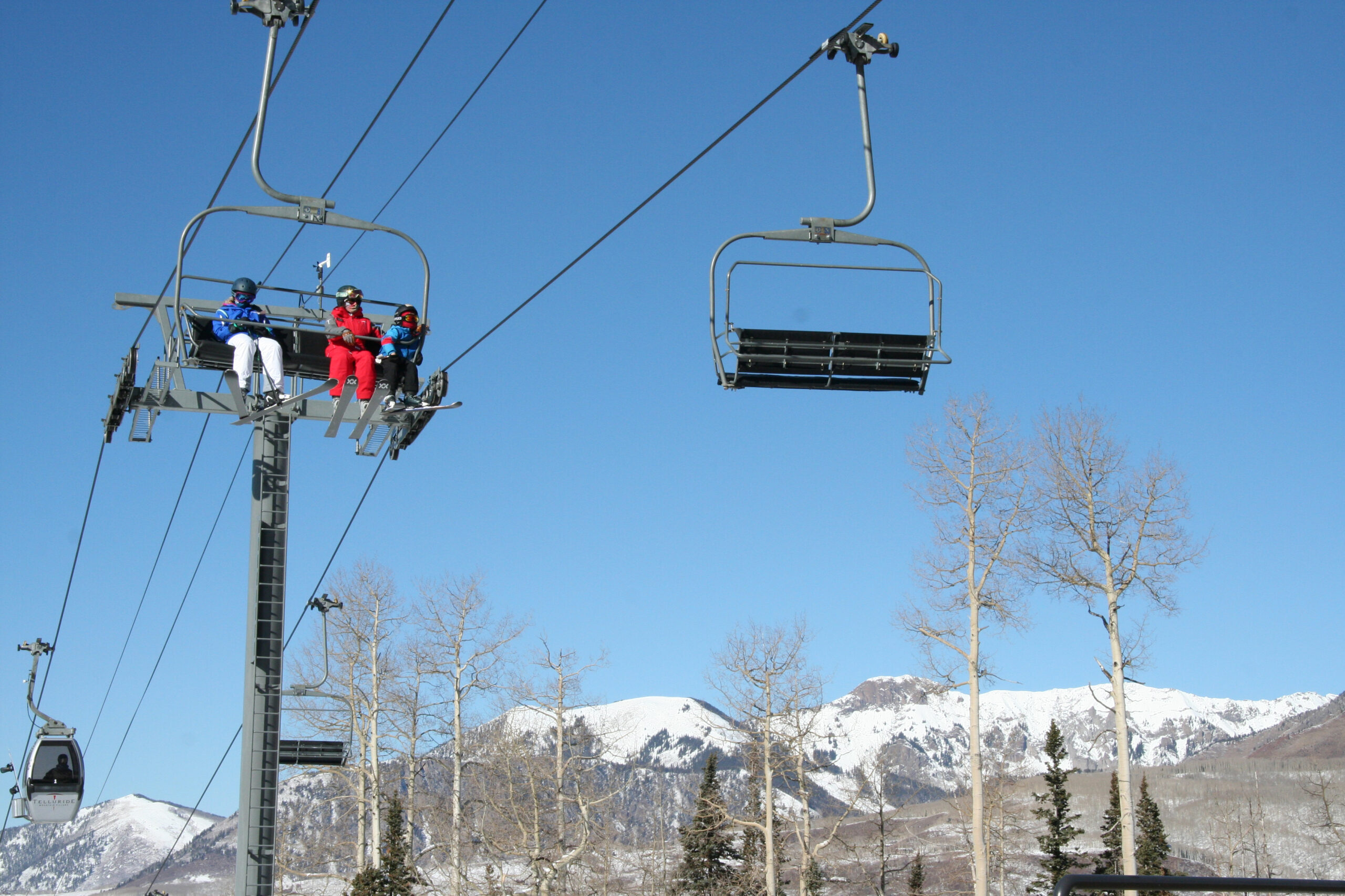People from the same household can stand in line together and ride Telluride's lifts next to one another, but when riding a lift with someone from another household, guests are asked to leave a vacant seat between them.