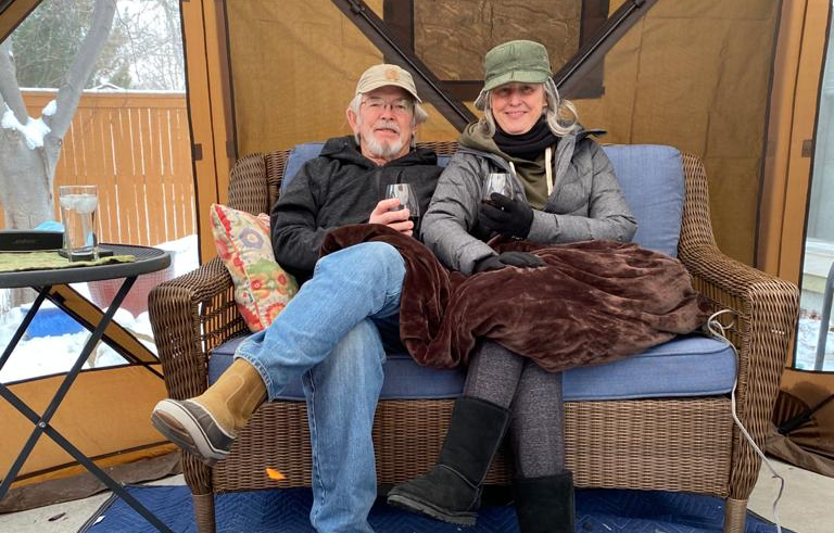 Bob and Maureen Thrash in their outdoor tent for safe holiday gatherings.