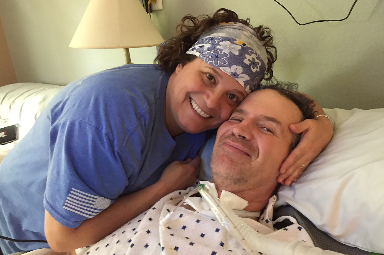 Lara Garey comforts her husband Tom in 2019. Tom served in the Air Force from 1989-1996 and was diagnosed with service related ALS in 2016.