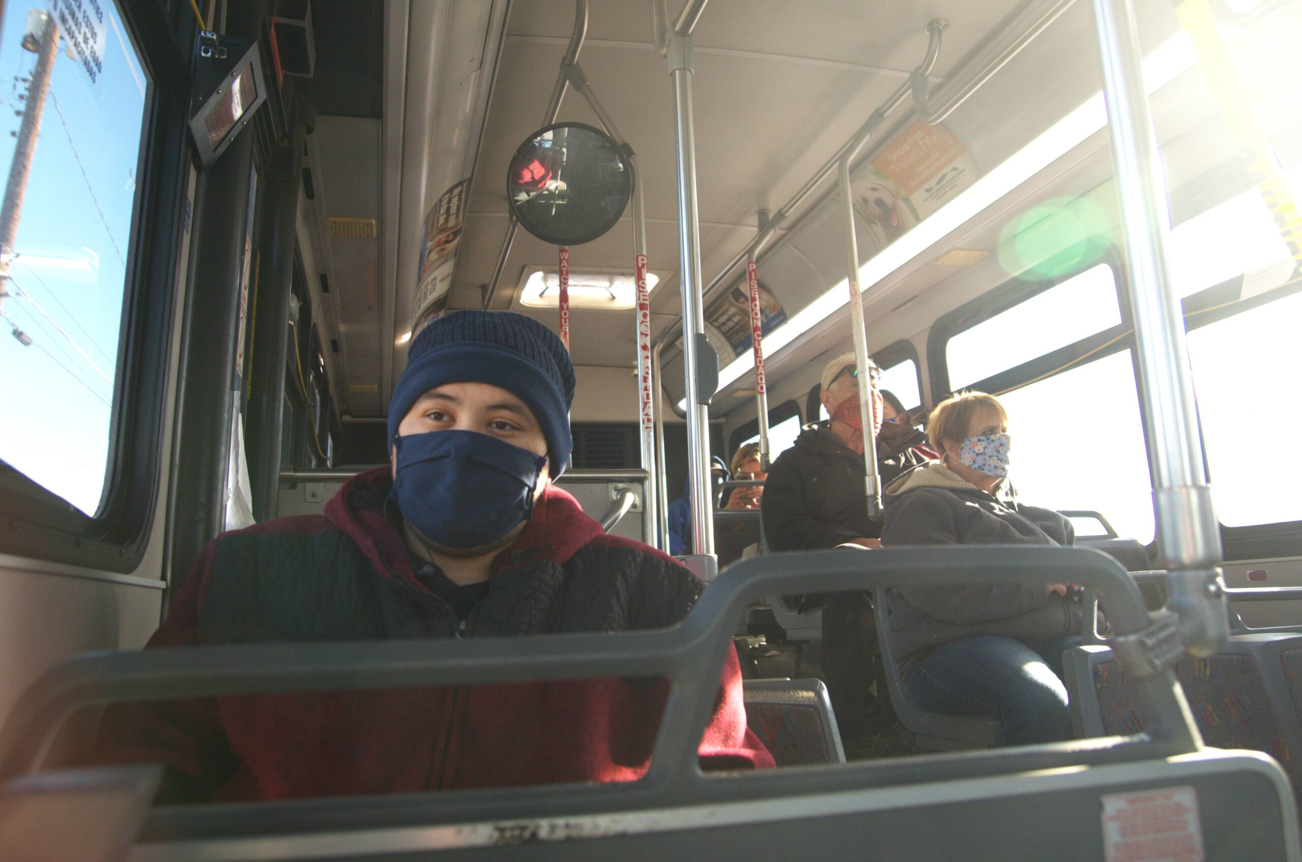 Jesse Espinoza, left, has dreams of getting into the entertainment business. On Wednesday, Dec. 16, 2020, he was riding Pueblo Transit to a plasma center.
