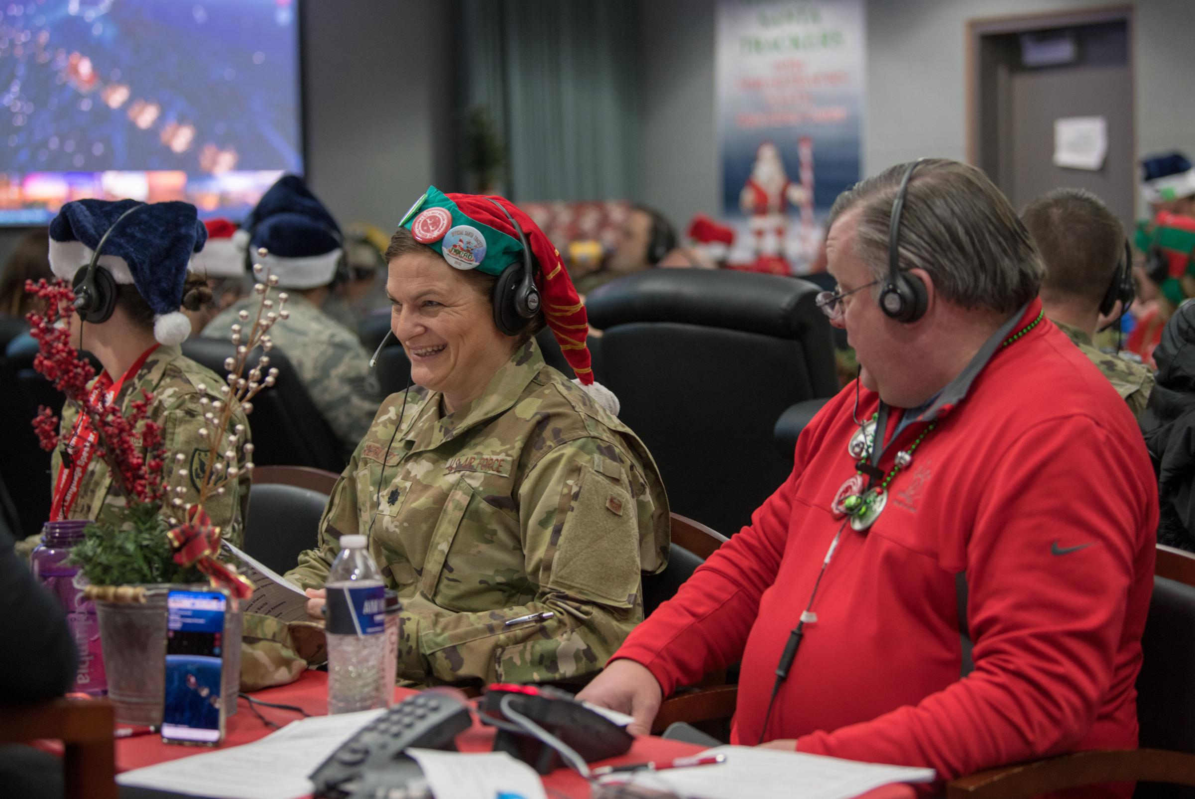 Air Force personnel work with volunteers to answer calls to NORAD's Santa tracking hotline on Christmas Eve 2019. This year, the operation has been scaled back, but is still running, because of the COVID-19 pandemic.