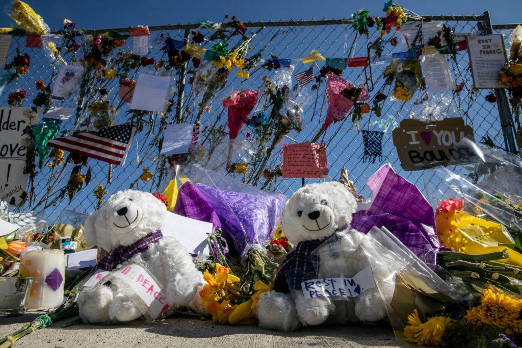 210329 BOULDER SHOOTING MEMORIAL FLOWERS SIGN