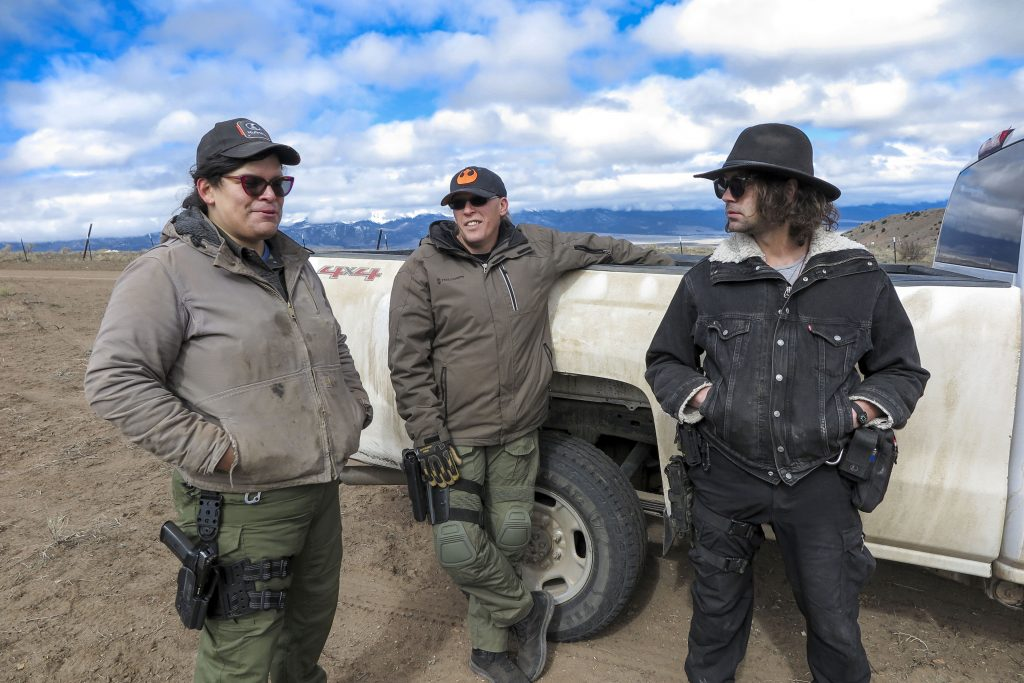 Tenacious Unicorn Ranch owners Bonnie Nelson and Penny Logue discuss heightened security measures on their property with ranch member J Stanley on April 28, 2021.
